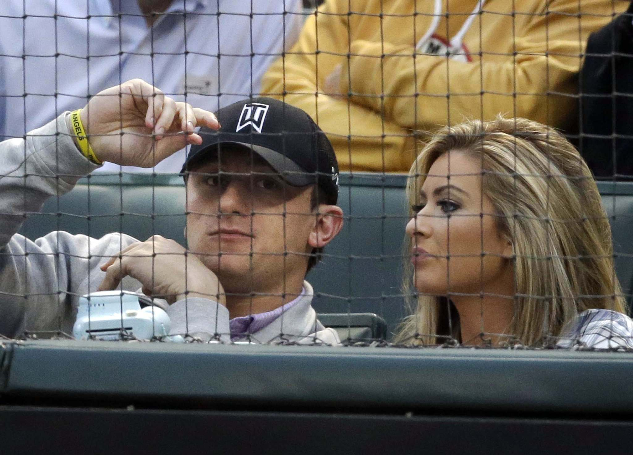 Johnny Manziel and Colleen Crowley at a baseball game in April 2015. (Associated Press files)