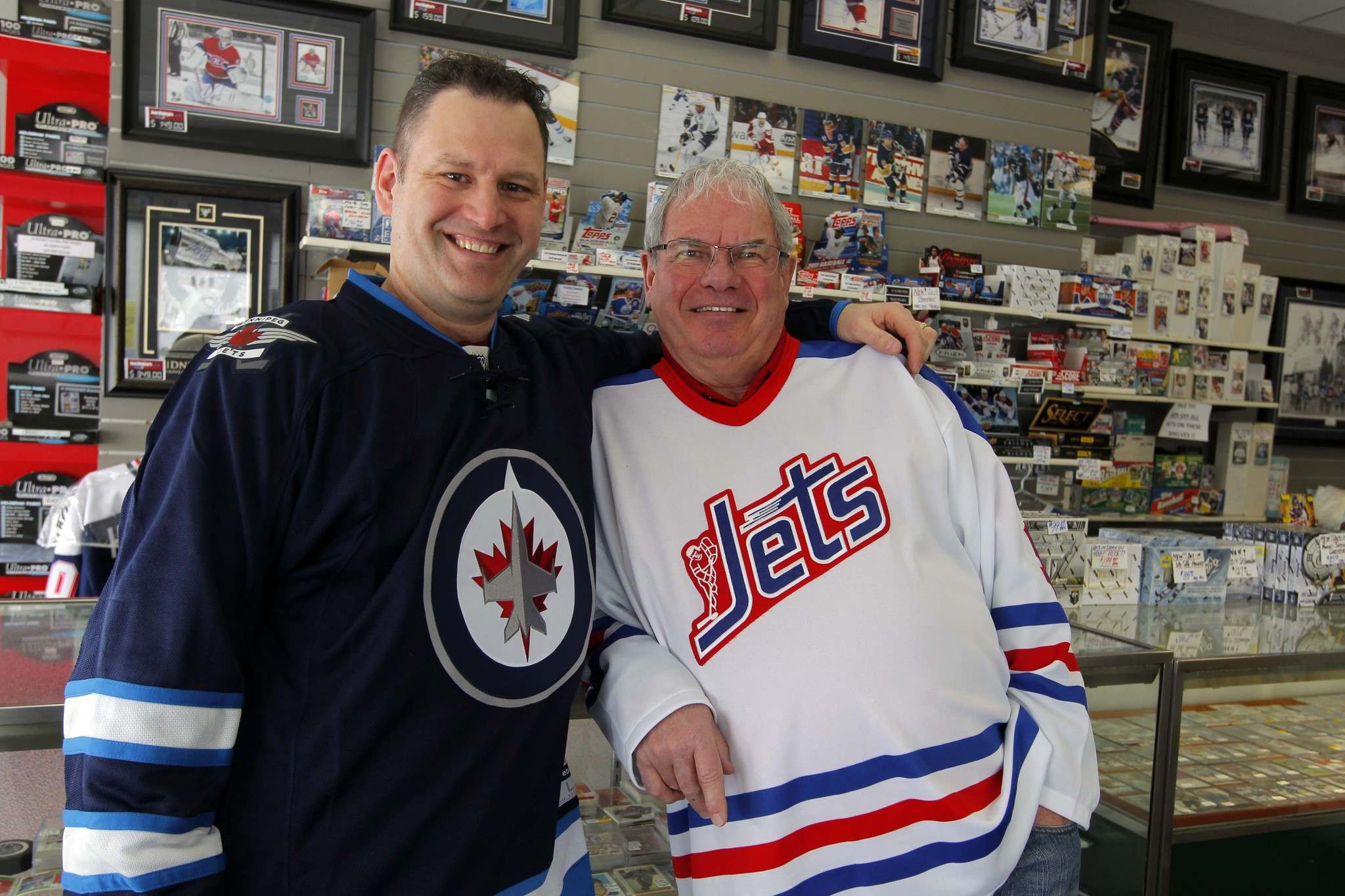 BORIS MINKEVICH / WINNIPEG FREE PRESS</p><p>Joe Daley (right), seen here with his son Travis in 2014, operates Joe Daley&#39;s Sports Cards. He opened the store 10 years after he retired from playing hockey.</p>
