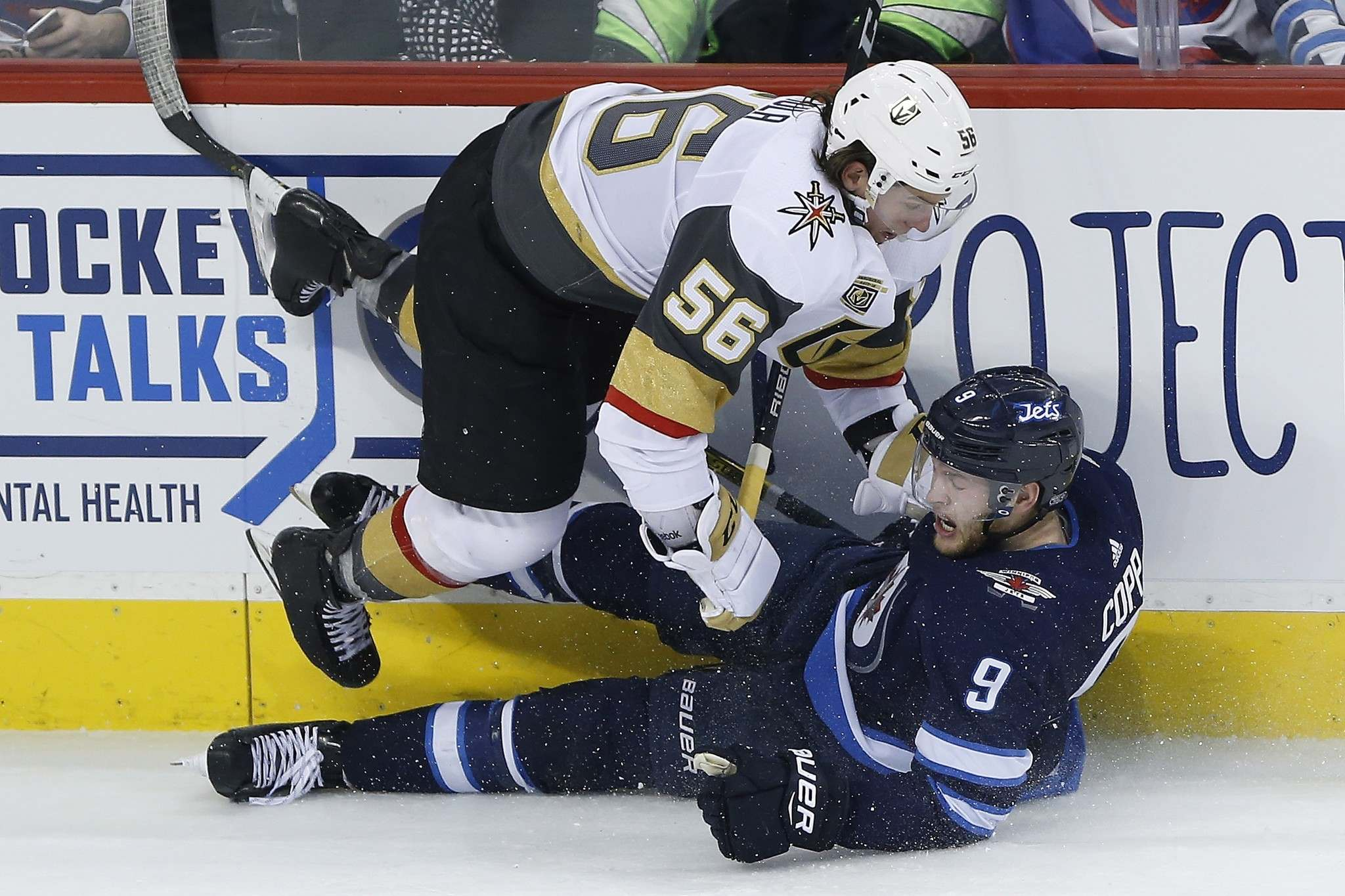 Vegas Golden Knights Erik Haula (56) and Winnipeg Jets&#39; Andrew Copp (9) collide during third period NHL action in Winnipeg on Thursday, February 1, 2018. THE CANADIAN PRESS/John Woods</p>