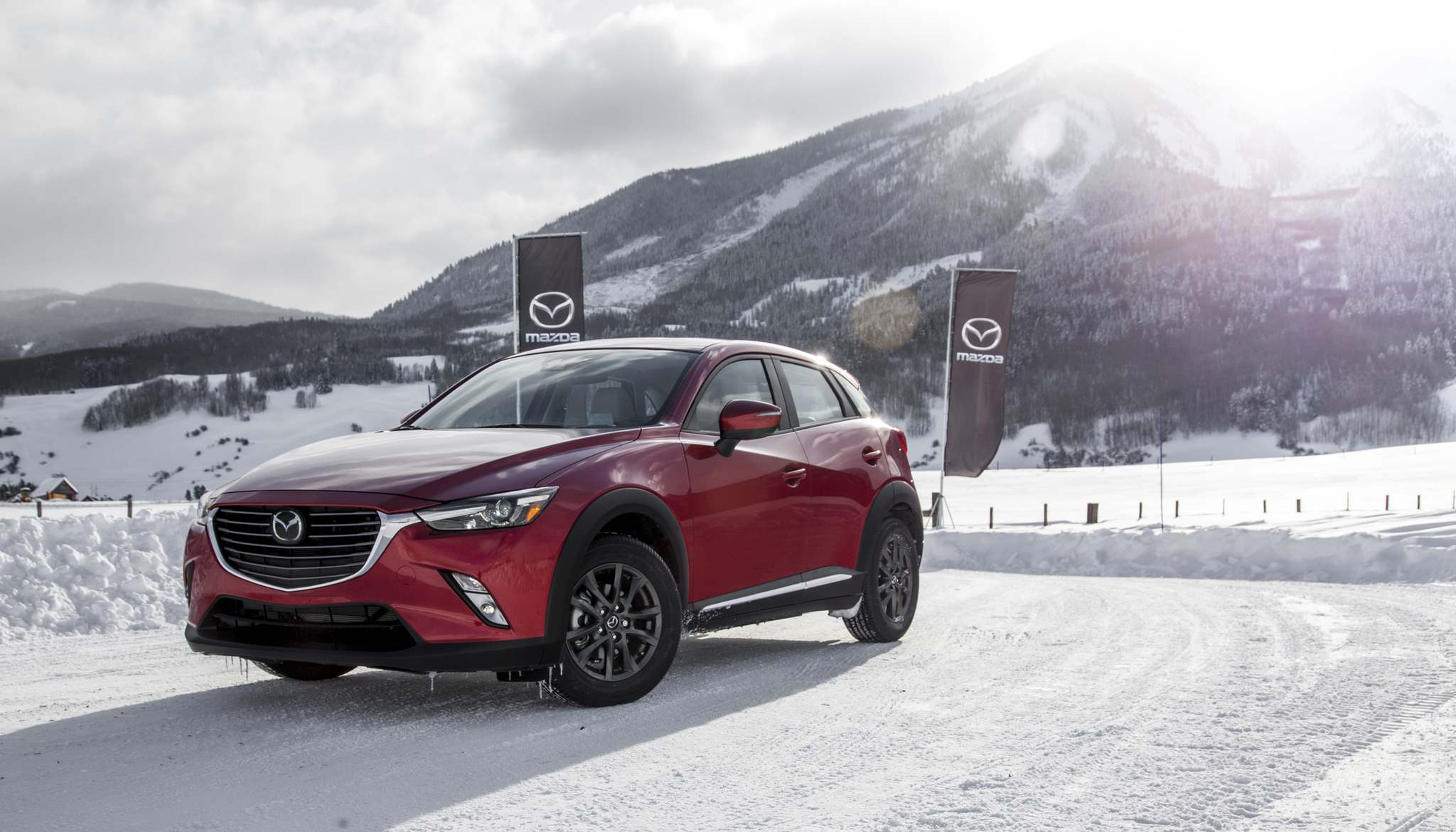 Mazda G-Vectoring Control, Smart City Brake Support, hill start assist, tire pressure monitoring, push-button start, cruise control, Bluetooth, a seven-inch display, rear-view camera and auto-off headlights are standard with the GX.