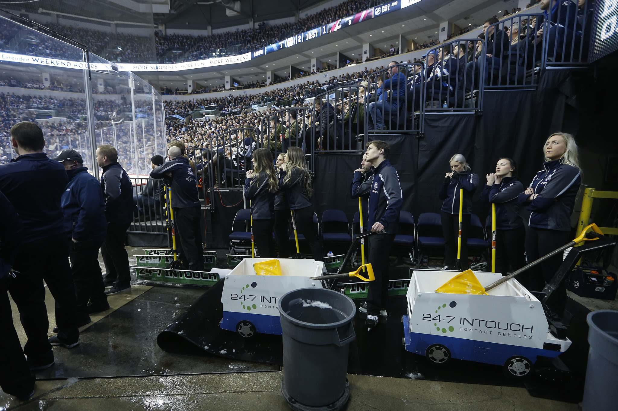 Member of the Ice Crew wait to step onto the ice during the first period of the NHL game between the Winnipeg Jets and the Arizona Coyotes.