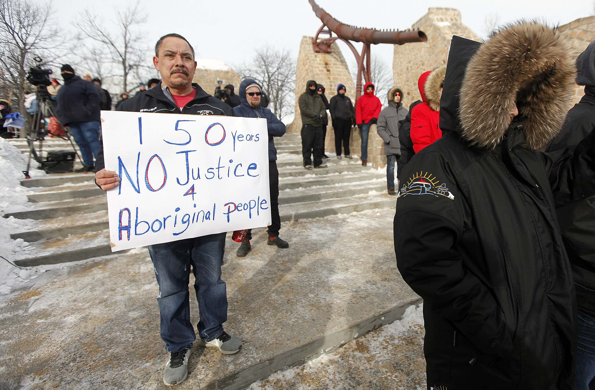 PHIL HOSSACK / WINNIPEG FREE PRESS</p><p>A man bears silent witness with his banner at The Forks.</p>