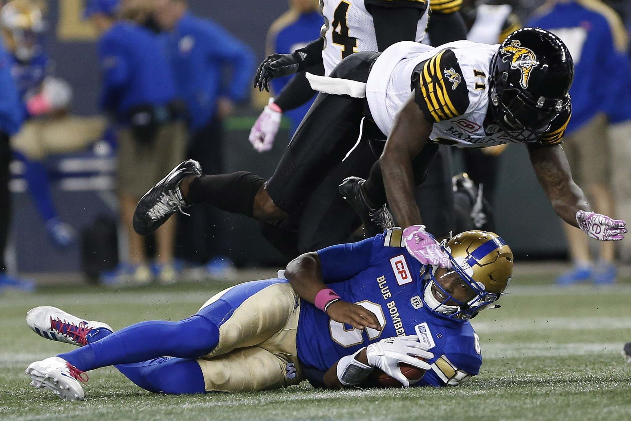 John Woods / THE CANADIAN PRESS FILES</p><p>The Hamilton Tiger-Cats&rsquo; Larry Dean, seen leaping over Winnipeg Blue Bombers quarterback Dominique Davis during a game in October, could push the Blue and Gold to the next level.</p>
