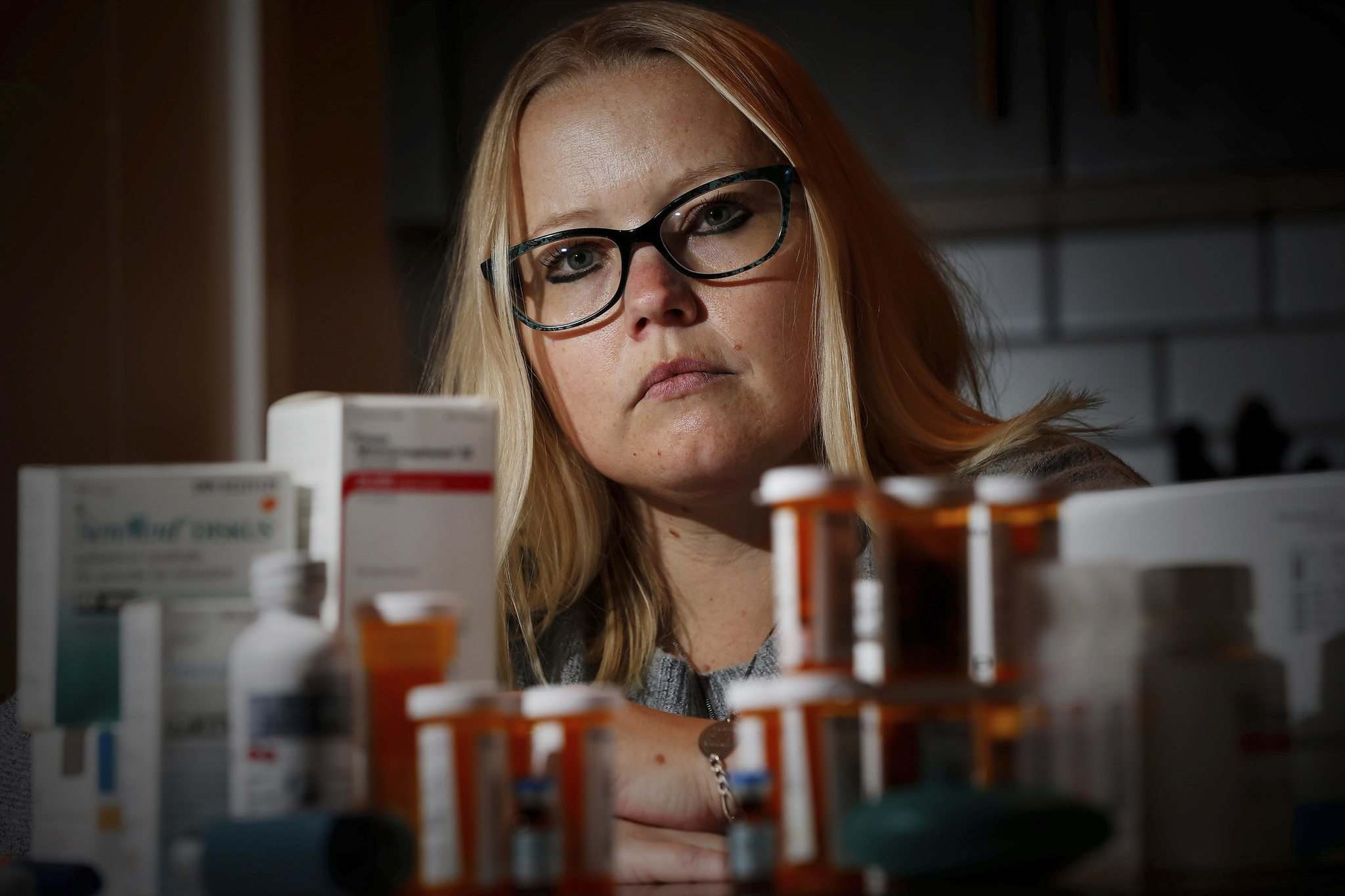 JOHN WOODS / WINNIPEG FREE PRESS</p><p>Tara-Lynn Reeves, who has cystic fibrosis, is seen at her home with the medication she takes on a daily basis. She thinks the province's decision will cost her about $7,000 a year.</p>