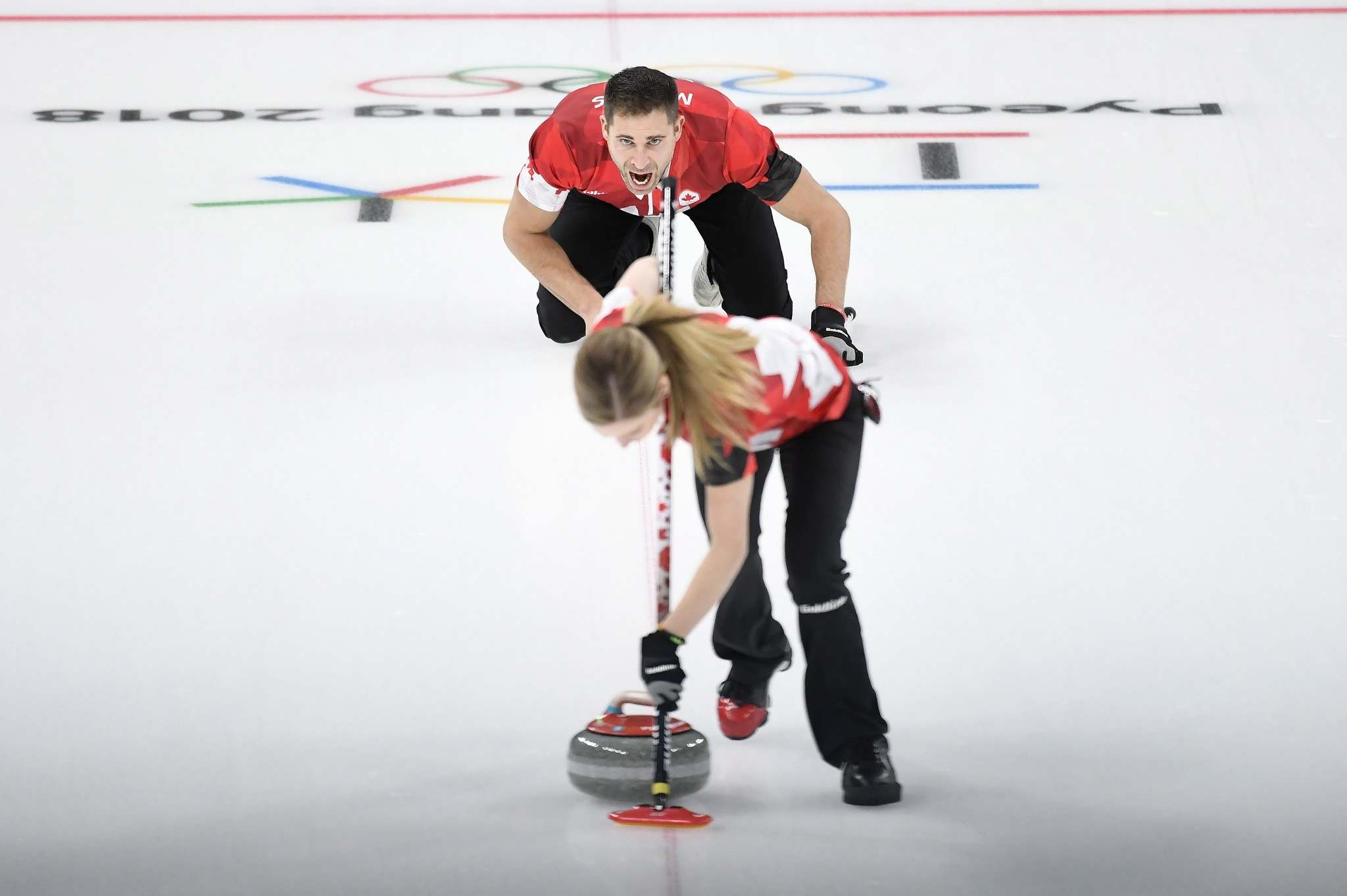 Nathan Denette / The Canadian Press</p><p>Canada&#39;s Kaitlyn Lawes and teammate John Morris play their stone during mixed doubles gold-medal curling action against Switzerland at the Olympic Winter Games in Gangneung, South Korea on Tuesday.</p>