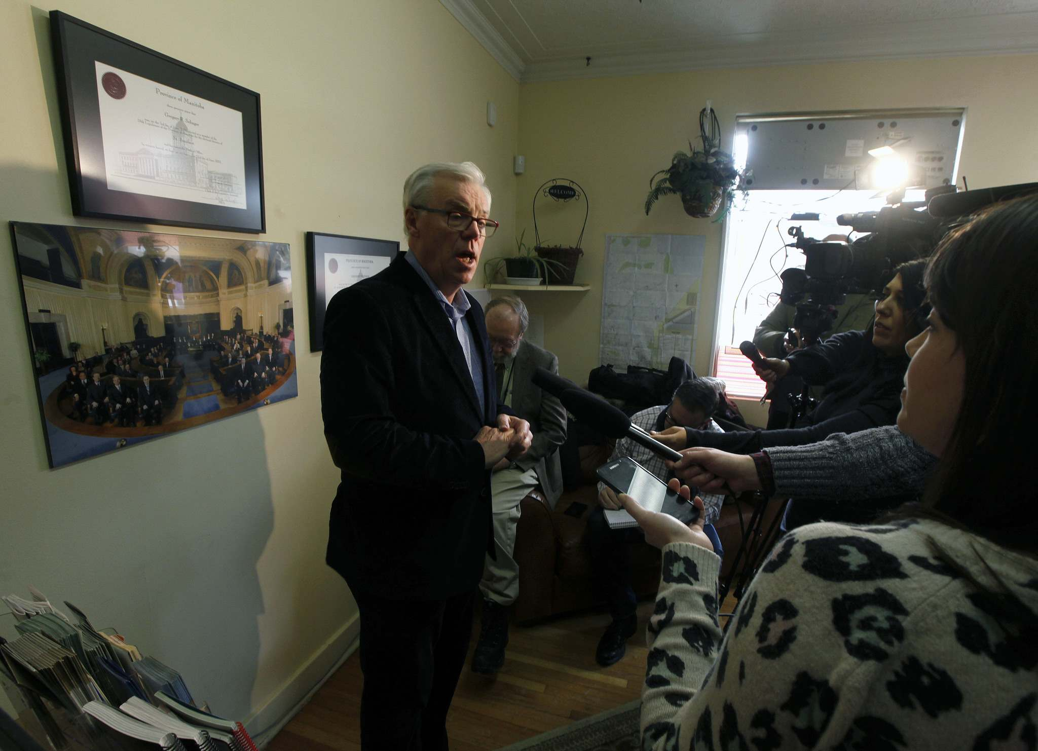 Greg Selinger meets the media at his St. Boniface constituency office on Tuesday, saying he will defy his party leader, Wab Kinew, and not resign. (Phil Hossack / Winnipeg Free Press files)</p>