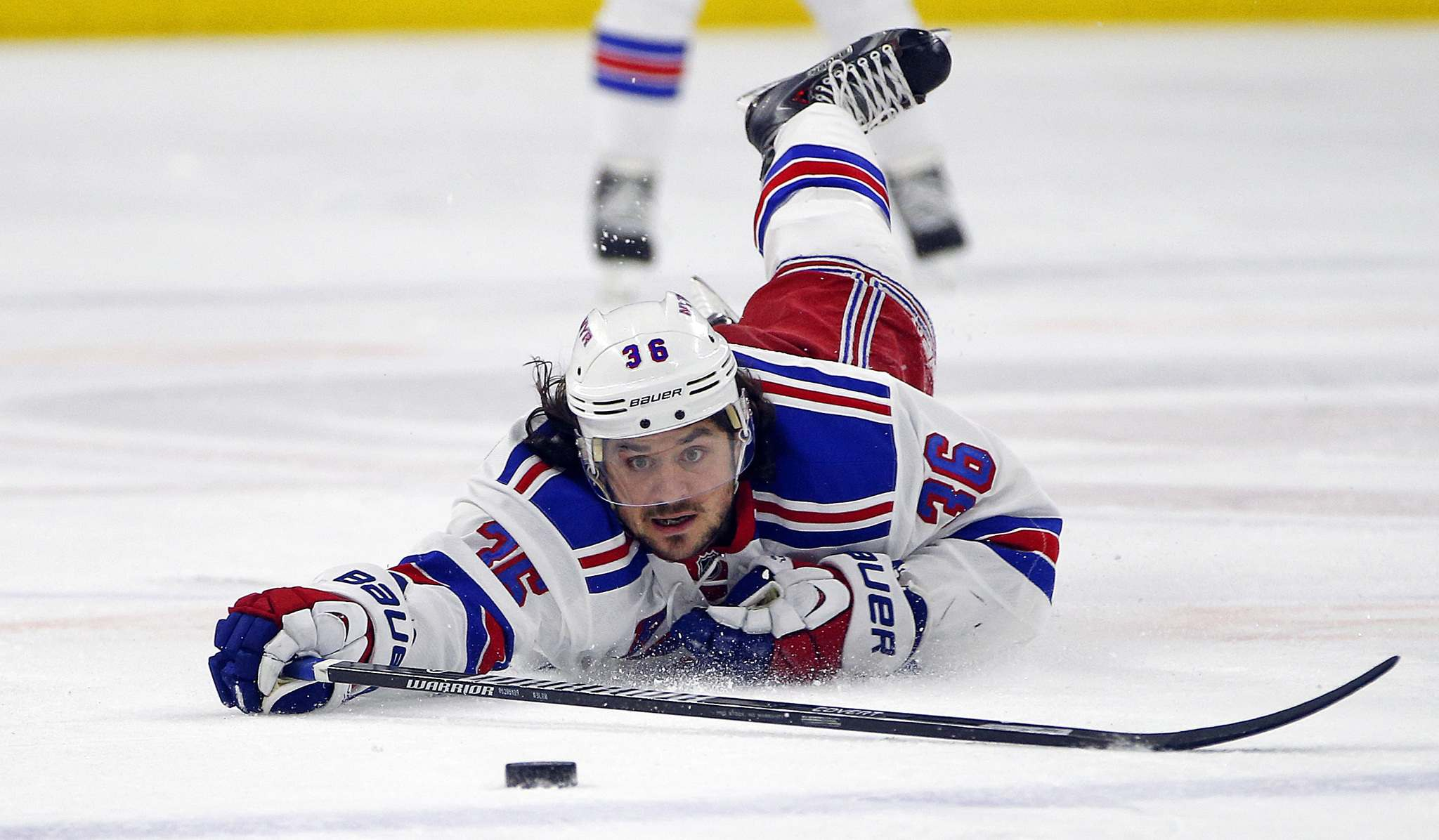 Mats Zuccarello dives for the puck during a game against the Carolina Hurricanes. (Karl B DeBlaker / Associated Press files)</p>