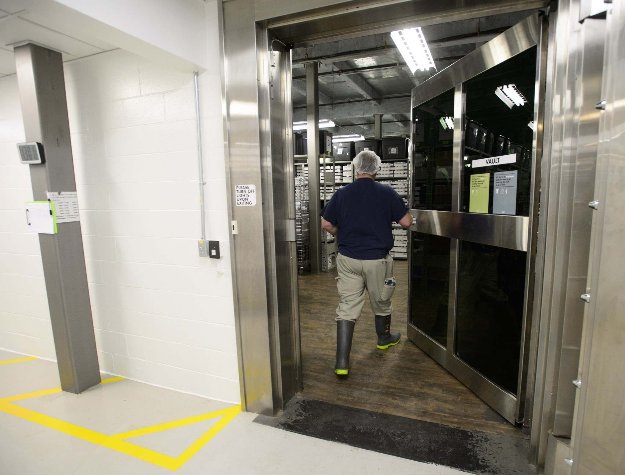 A worker enters the high-security vault at the Canopy Growth facility in Smiths Falls, Ont.,  Monday.