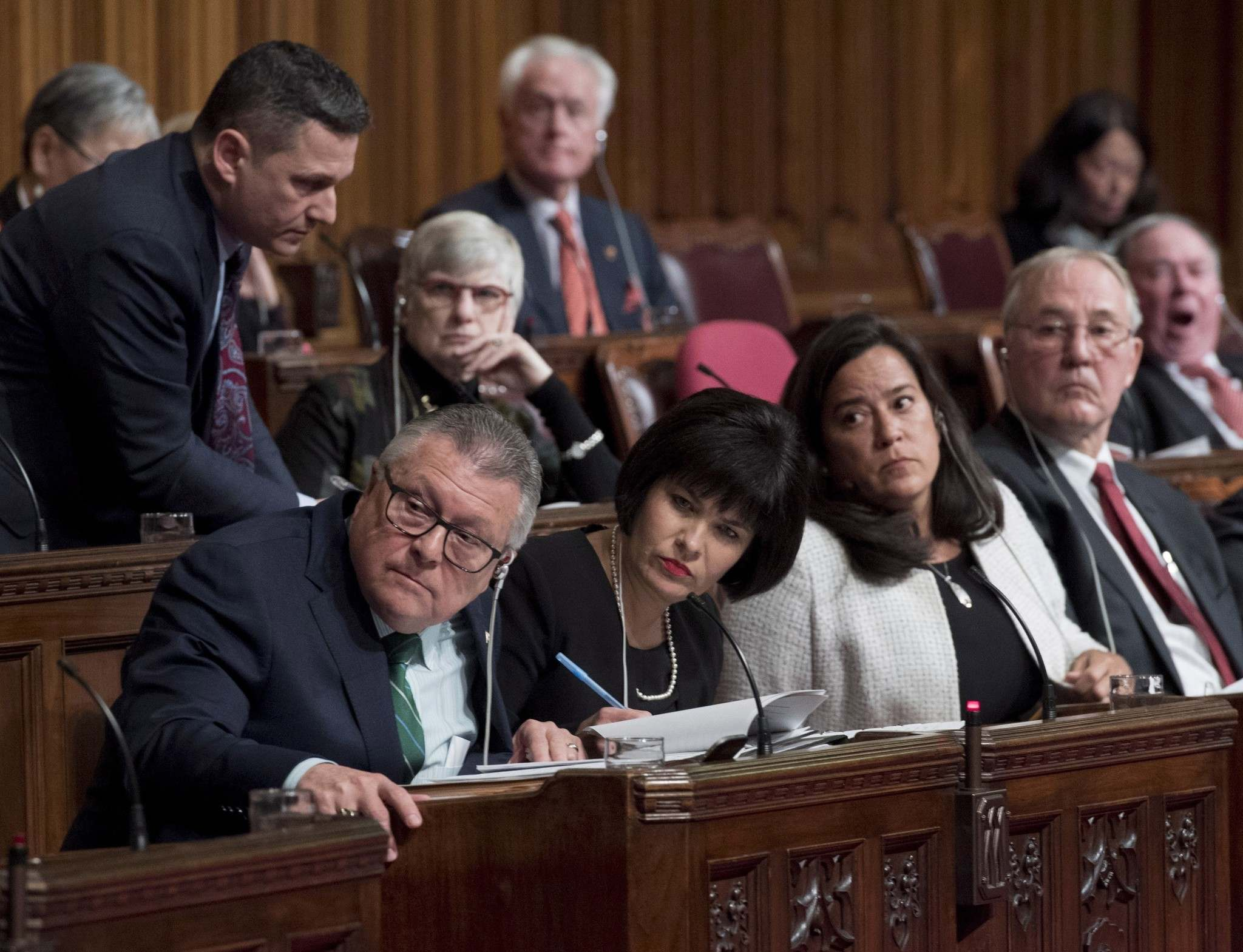Minister of Public Safety and Emergency Preparedness Ralph Goodale, Minister of Health Ginette Petitpas Taylor, Minister of Justice and Attorney General of Canada Jody Wilson-Raybould and Bill Blair, M.P., Parliamentary Secretary to the Minister of Justice and the Attorney General of Canada and the Minister of Health, listen to a question during a televised Senate hearing on Bill C-45 on Tuesday, Feb. 6, 2018.