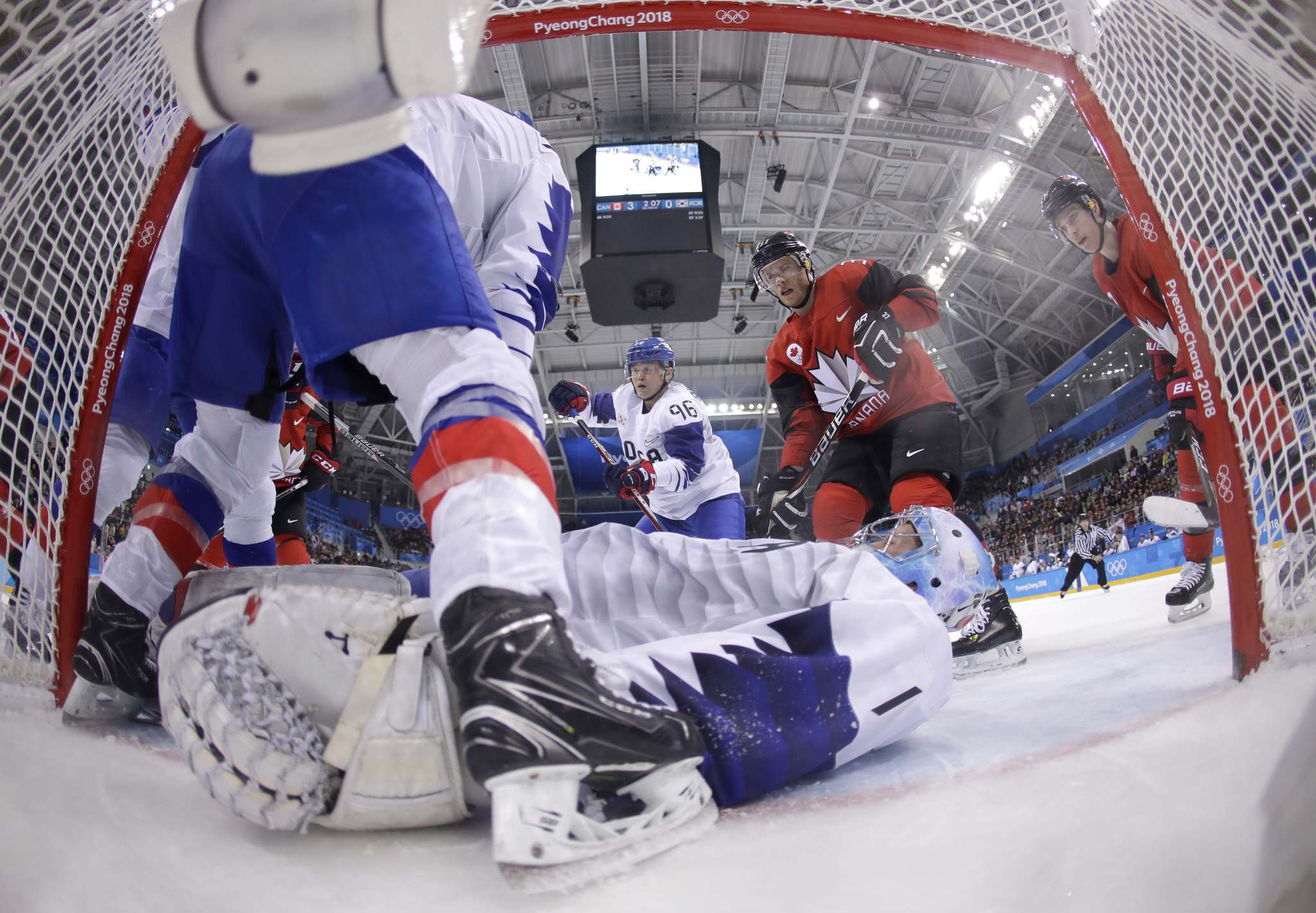 Julio Cortez / The Associated Press</p><p>Goalie Matt Dalton (1), of South Korea, lays out to stop the puck during the third period of the preliminary round of the men's hockey game against Canada at the 2018 Winter Olympics in Gangneung, South Korea, Sunday, Feb. 18, 2018. </p>