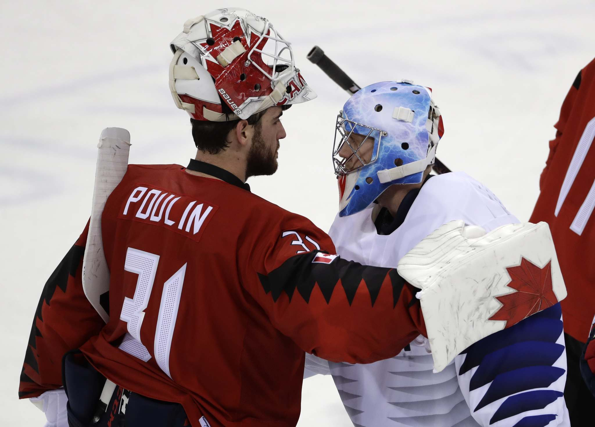 Matt Slocum / The Associated Press</p><p>Kevin Poulin (31), of Canada, greets Matt Dalton (1), of South Korea, after the preliminary round of the men's hockey game at the 2018 Winter Olympics in Gangneung, South Korea, Sunday, Feb. 18, 2018. Canada won 4-0.</p></p>