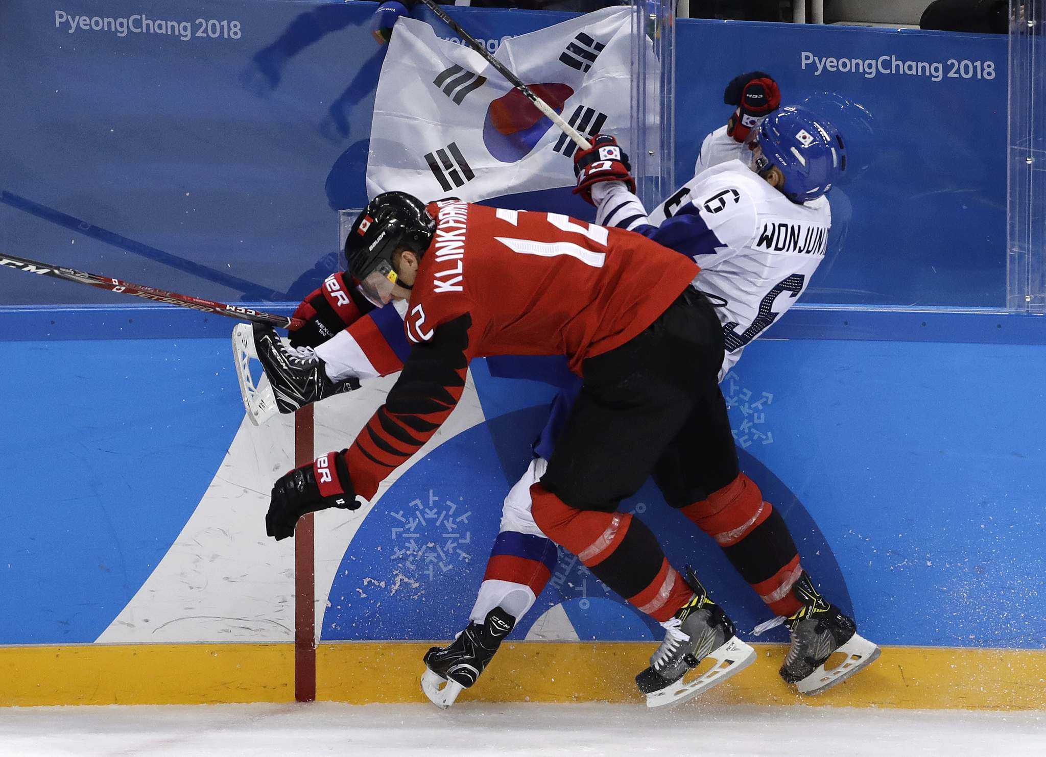 Matt Slocum / The Associated Press</p><p>Rob Klinkhammer (12), of Canada, checks Kim Won-jun (6), of South Korea, during the third period of the preliminary round of the men's hockey game at the 2018 Winter Olympics in Gangneung, South Korea, Sunday, Feb. 18, 2018.</p></p>