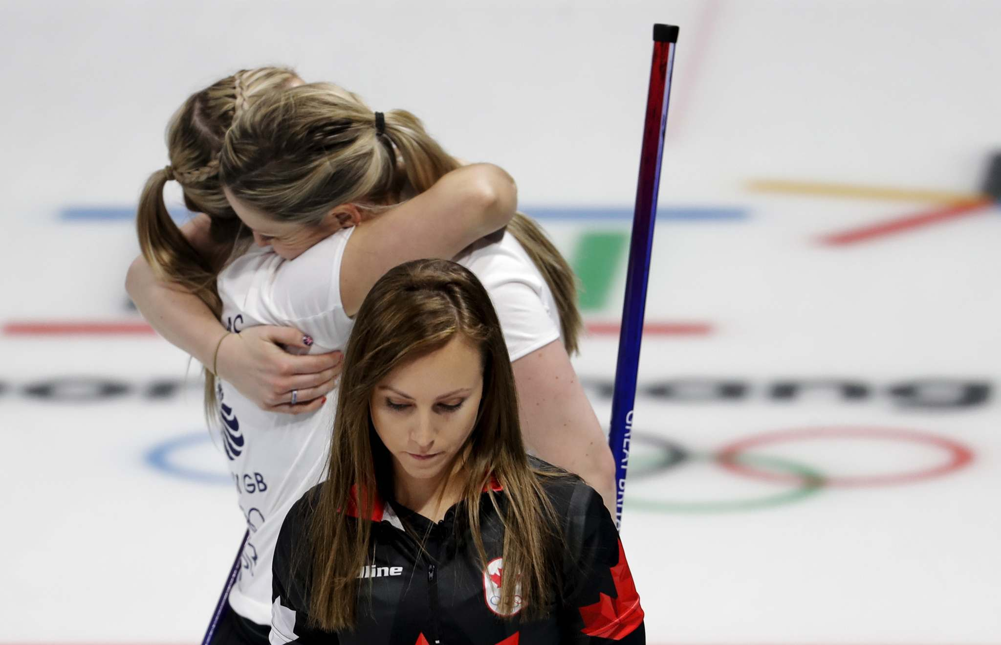 AP Photo/Natacha Pisarenko</p><p>Canada's skip Rachel Homan, centre, leaves the ice as Britain's Lauren Gray and Vicki Adams celebrate winning their curling match at the 2018 Winter Olympics in Gangneung, South Korea, Wednesday. Homan's is the first Canadian curling team to not win an olympic medal.</p>