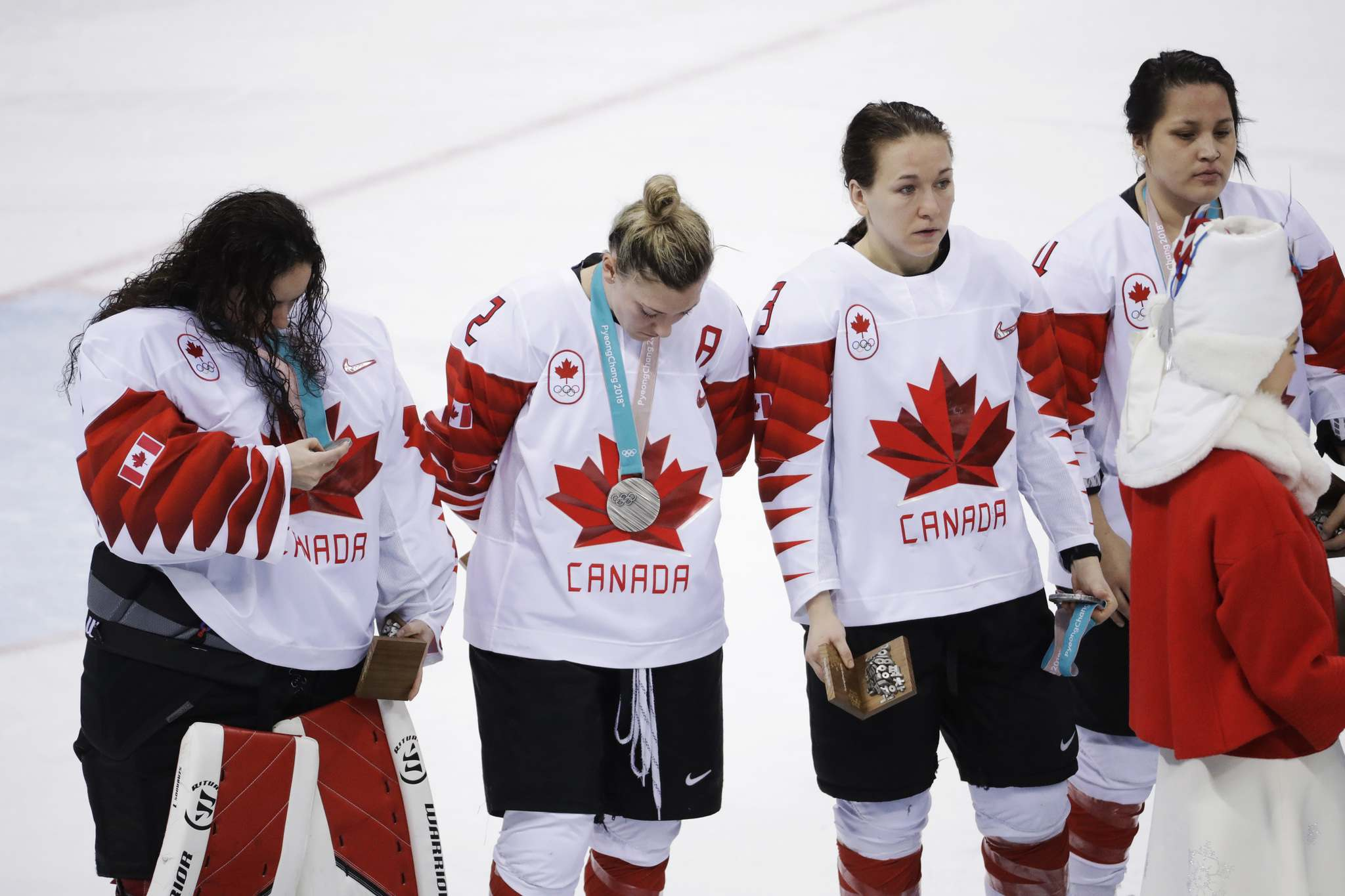 (AP Photo/Matt Slocum)</p><p>Jocelyne Larocque of Canada, third from left, holds her silver medal after losing to the United States in the women's gold medal hockey game at the 2018 Winter Olympics in Gangneung, South Korea, Thursday.</p>