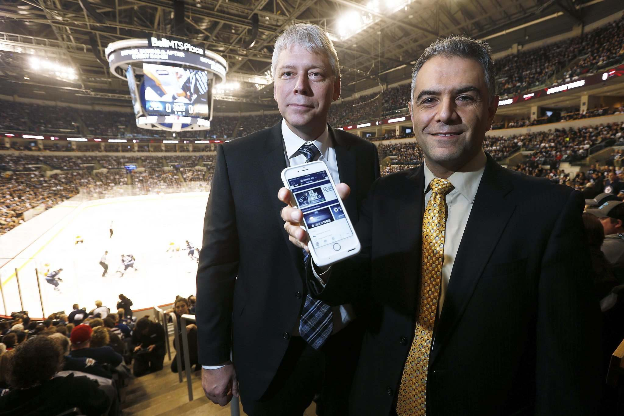 JOHN WOODS / WINNIPEG FREE PRESS</p><p>True North Sports & Entertainment chief operating officer John Olfert (left) and Fannex founder Kemal Leslie are excited to start pitching Fannex's interactive fan app to 800-plus sports teams across North America.</p></p>
