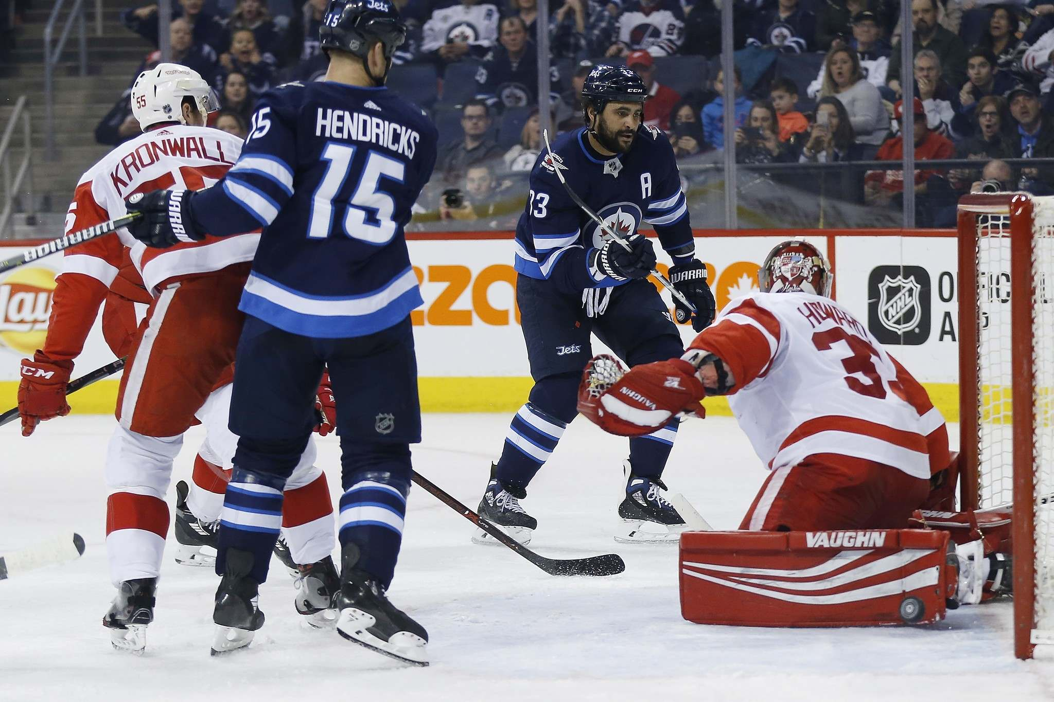 THE CANADIAN PRESS/John Woods</p><p>Winnipeg Jets' Dustin Byfuglien scores on Detroit Red Wings Jimmy Howard as Jets' Matt Hendricks and Red Wings' Niklas Kronwall look on during second period Friday. </p>