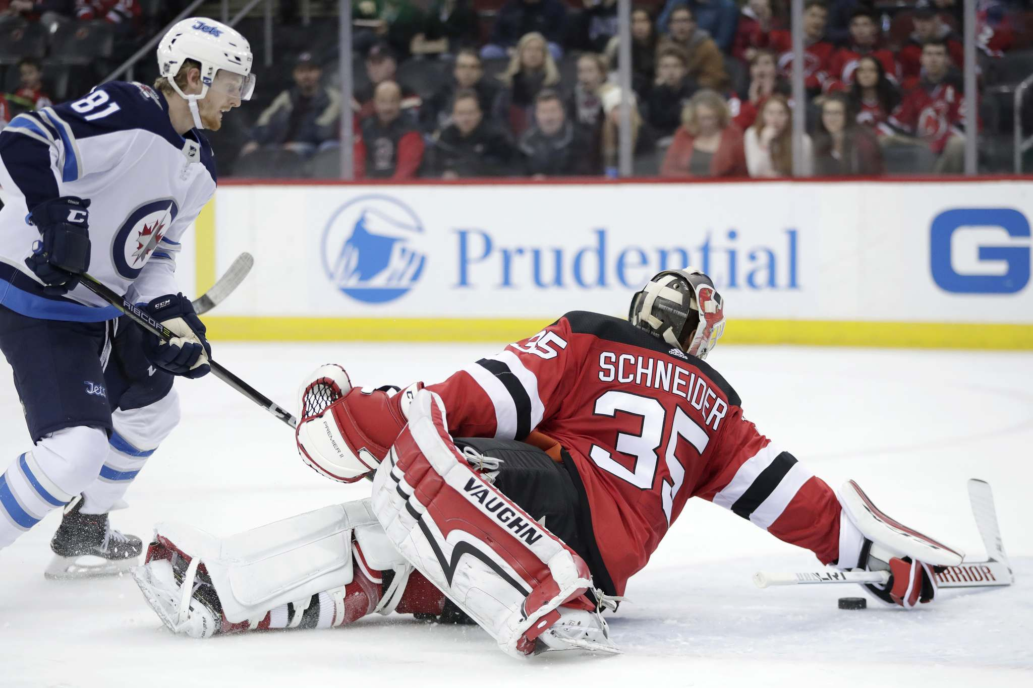 (AP Photo/Julio Cortez)</p><p>New Jersey Devils goaltender Cory Schneider (35) dives to deflect the puck out of his crease as Winnipeg Jets left wing Kyle Connor (81) attacks during the first period of an NHL hockey game, Thursday, March 8, 2018, in Newark, N.J. </p>