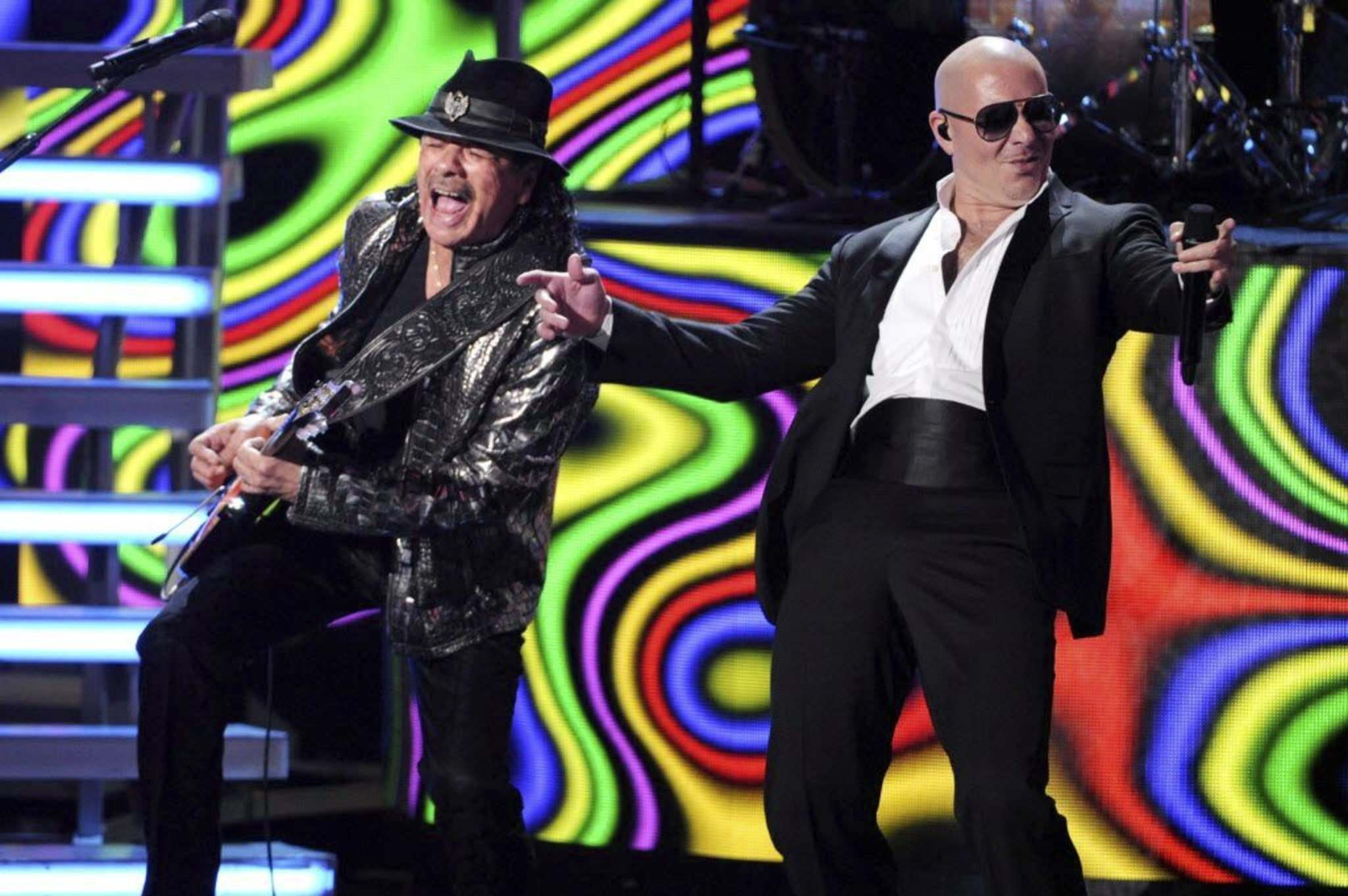 <p>Carlos Santana (left) teamed up with Pitbull in 2014 on a track called Oye. It&rsquo;s one of several collaborative efforts the mercurial guitarist has undertaken with less than stellar results.</p>