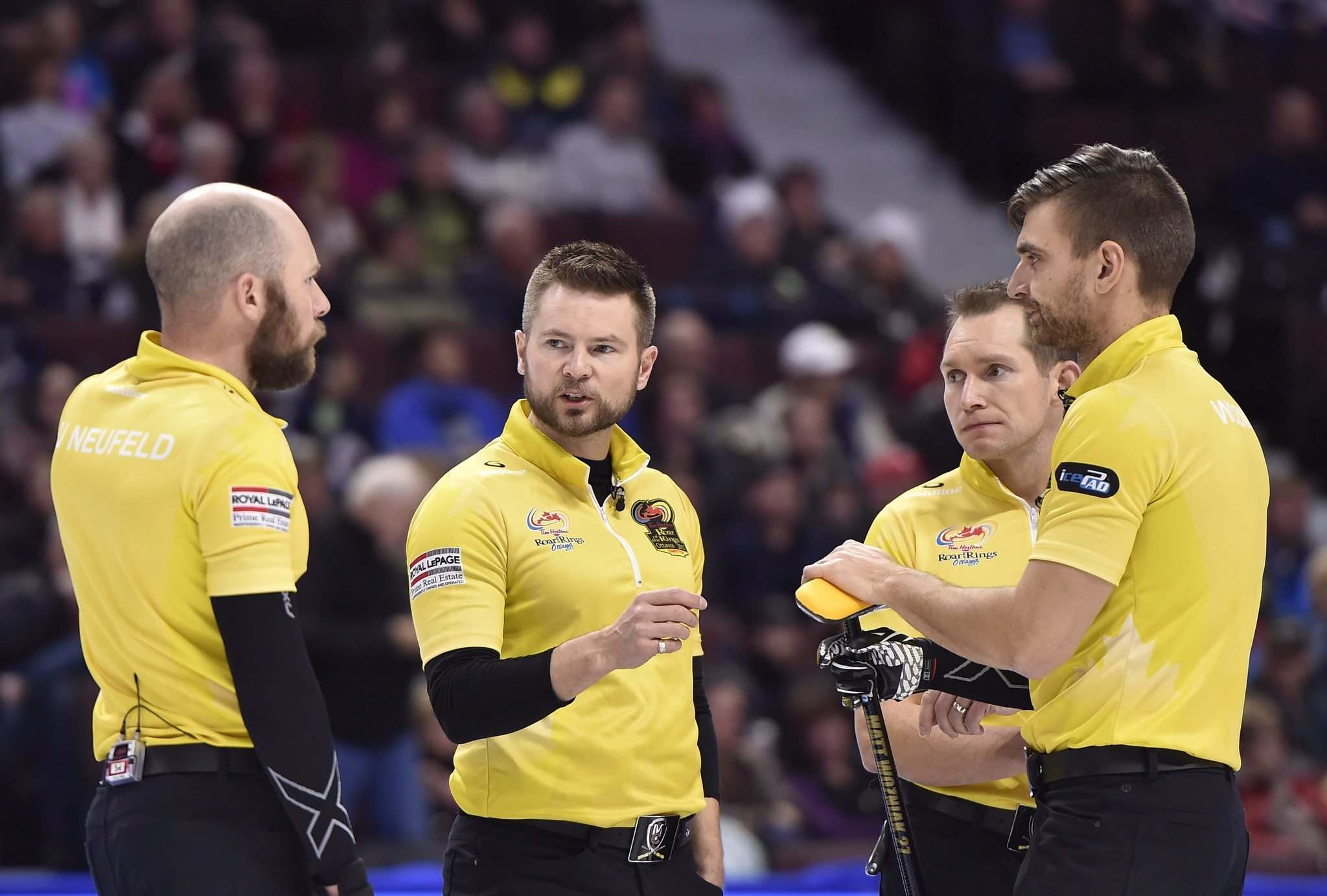 Skip Mike McEwen of Winnipeg, Man. talks with third B.J. Neufeld, left, second Matt Wozniak, second from right, and lead Denni Neufeld between ends during the men&#39;s semifinal at the 2017 Roar of the Rings Canadian Olympic Trials in Ottawa on Saturday, Dec. 9, 2017. THE CANADIAN PRESS/Justin Tang</p>