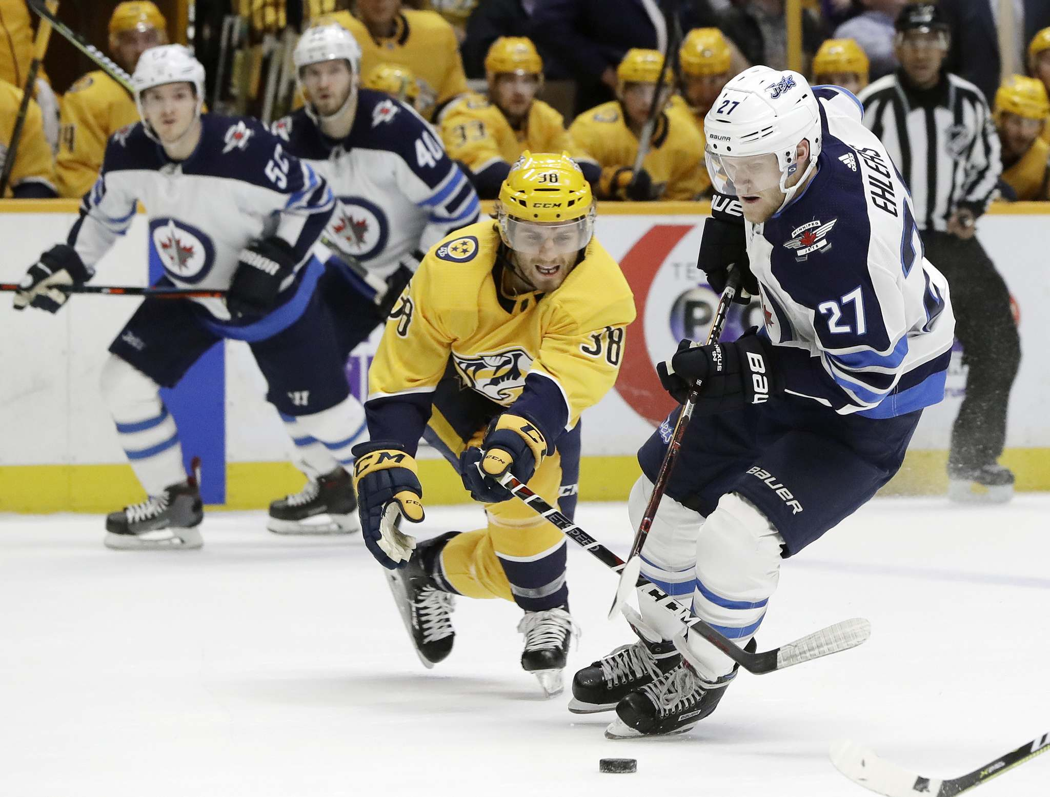 AP Photo/Mark Humphrey</p><p>Winnipeg Jets left wing Nikolaj Ehlers moves the puck against Nashville Predators right wing Ryan Hartman in the first period Tuesday in Nashville.</p>
