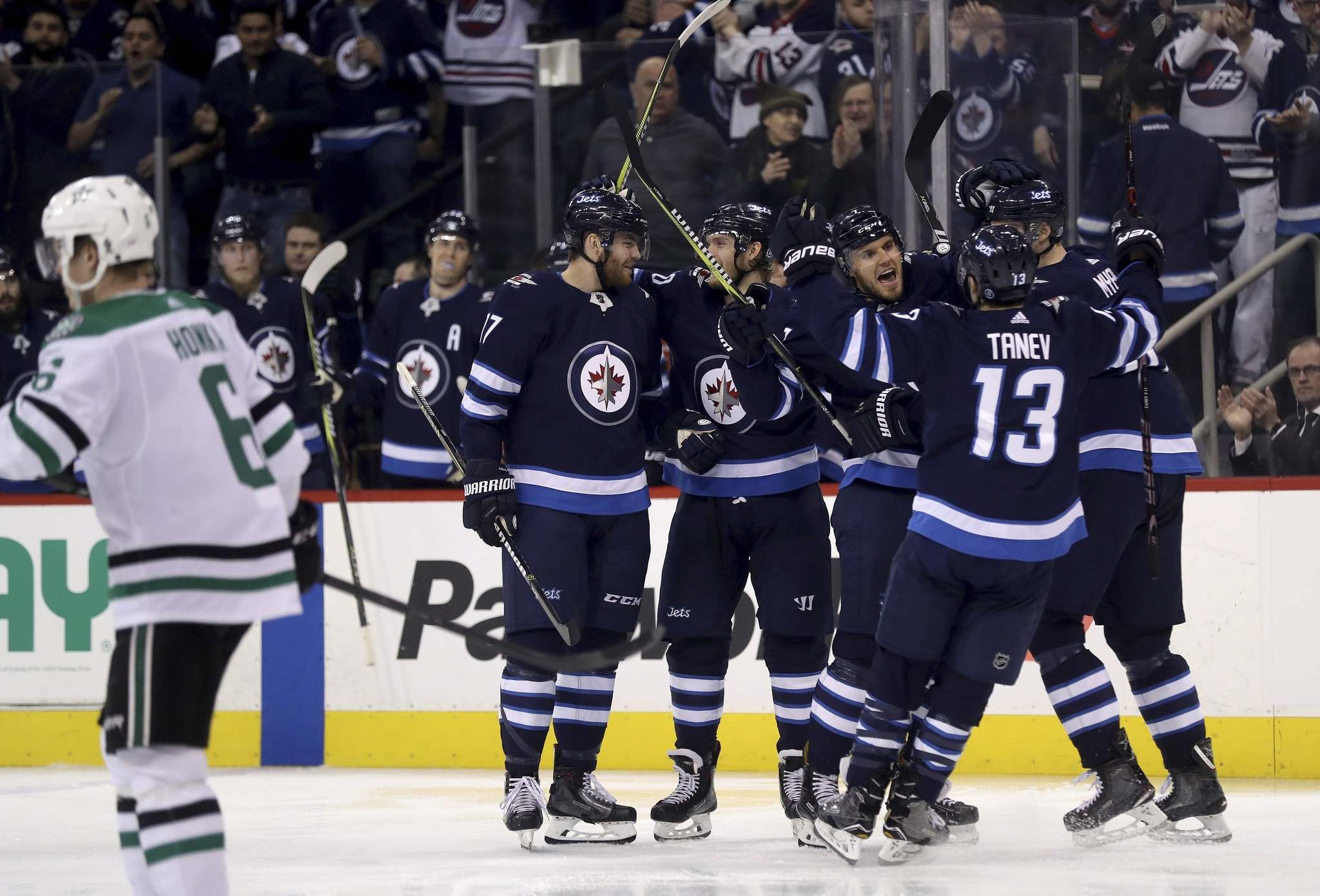 TREVOR HAGAN / THE CANADIAN PRESS</p><p>Winnipeg Jets&#39; Adam Lowry (17), Joel Armia (40), Ben Chiarot (7), Brandon Tanev (13) and Tyler Myers (57) celebrate after Chiarot scored during second period NHL hockey action against the Dallas Stars, in Winnipeg, Sunday, March 18, 2018.</p>