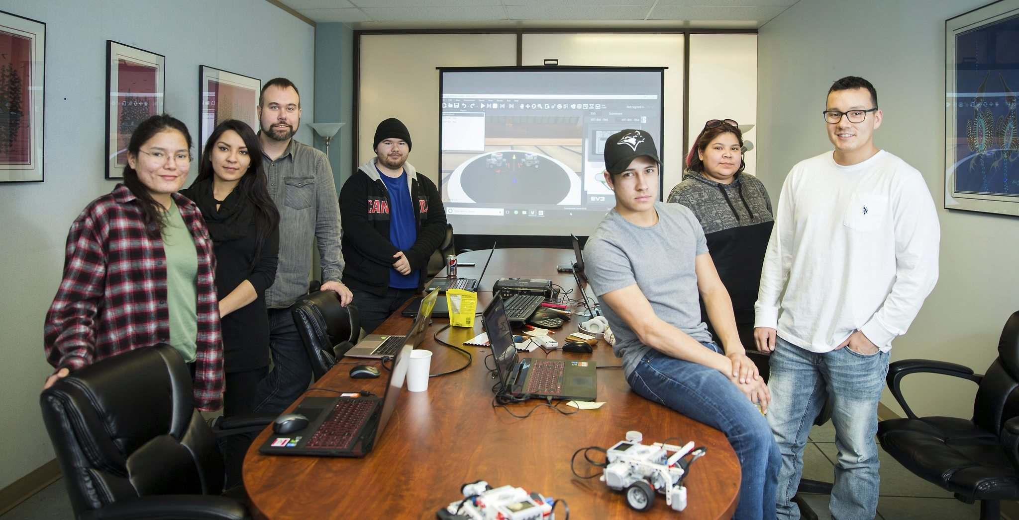 MIKAELA MACKENZIE / WINNIPEG FREE PRESS</p><p>Robotics instructors Lisa Harper (left), Alexis Nelson, Chris Schulz, Kane Slavuta, Shini Barratt, Tia Dumas, and Jared Bone at the First Peoples Development Inc. offices in Winnipeg on Thursday, March 15, 2018. First Peoples Development Inc. has teamed up with a Winnipeg robotics company called Cogmation to deliver two-week long robotics coding workshops in First Nations in Manitoba that culminate in a Lego robot Sumo wrestling competition.</p>