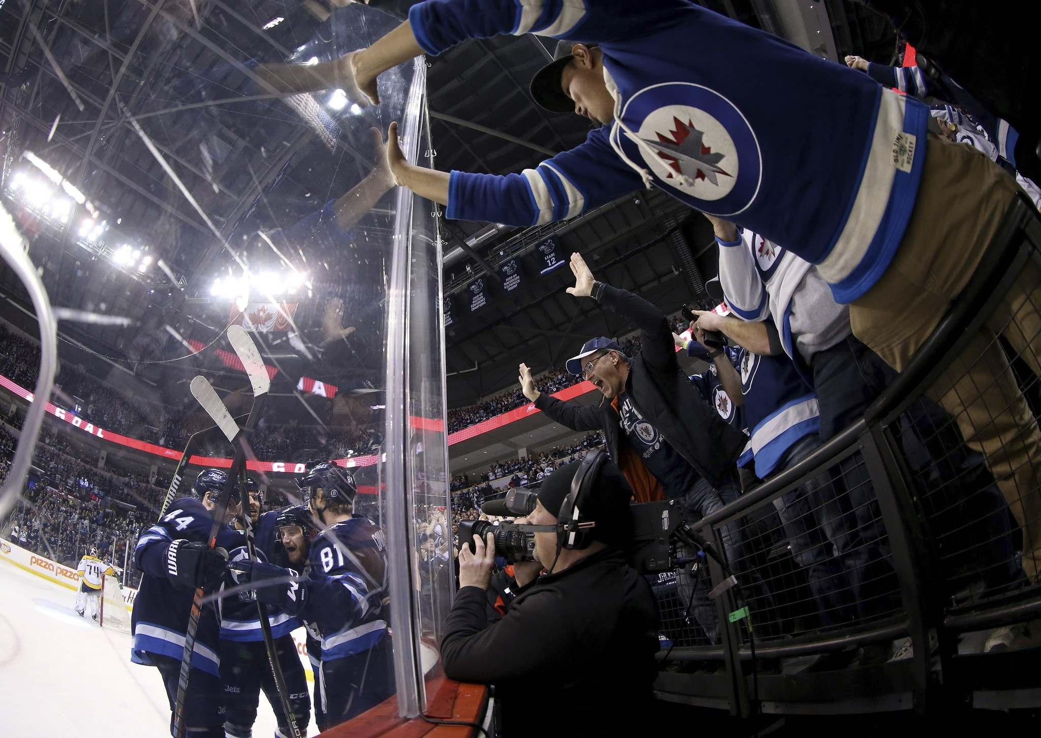 Winnipeg Jets&rsquo; Josh Morrissey (44), Ben Chiarot (7), Bryan Little (18) and Kyle Connor (81) celebrate after Little scored as Jets fans go crazy as the team played against the Nashville Predators&rsquo; during second period NHL hockey action in Winnipeg on March 25. (Trevor Hagan / The Canadian Press)</p>
