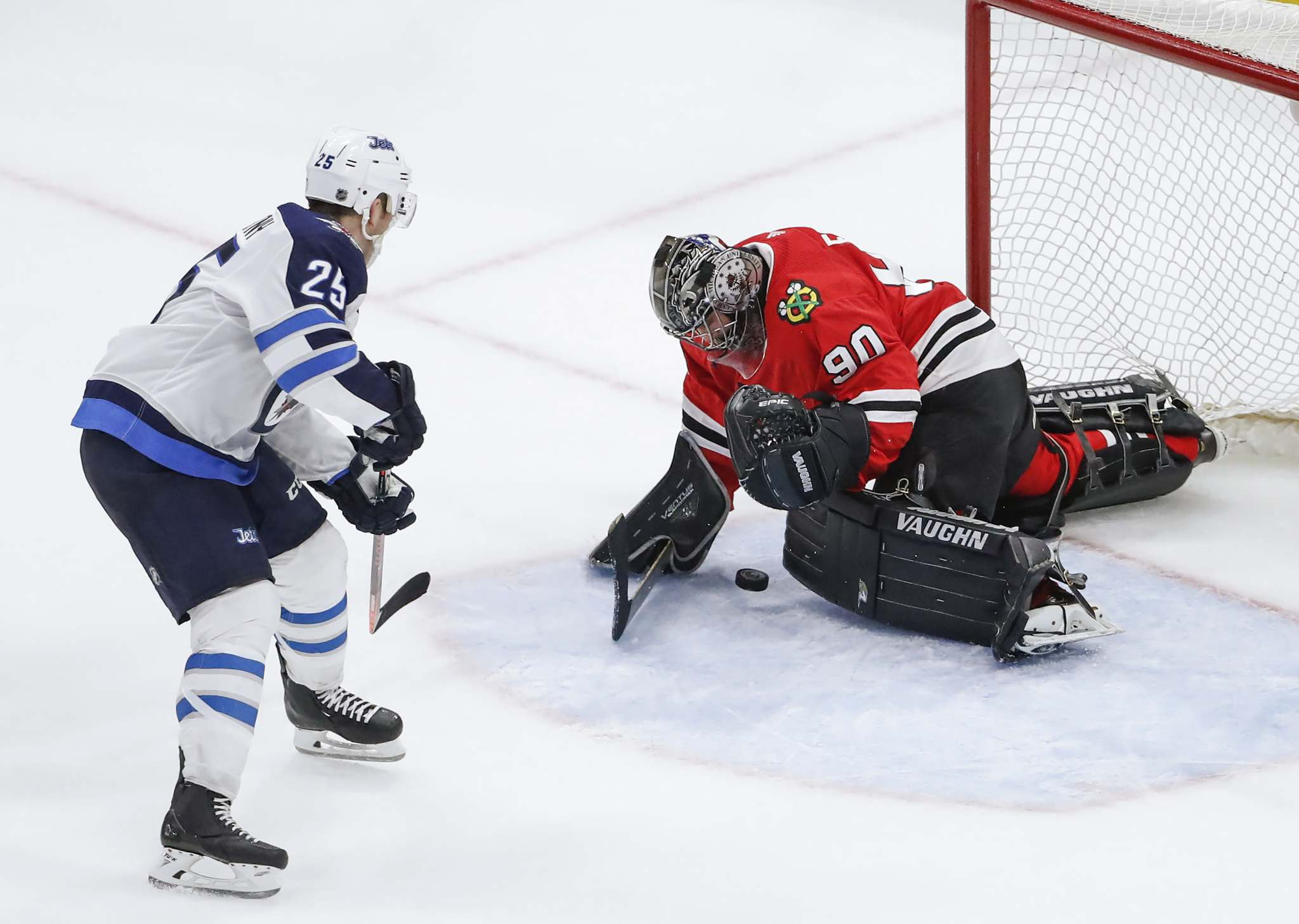 Kamil Krzaczynski / The Associated Press files</p><p>Chicago Blackhawks goalie Scott Foster makes a save on a shot by Winnipeg Jets centre Paul Stastny during Thursday's game in Chicago.</p></p>