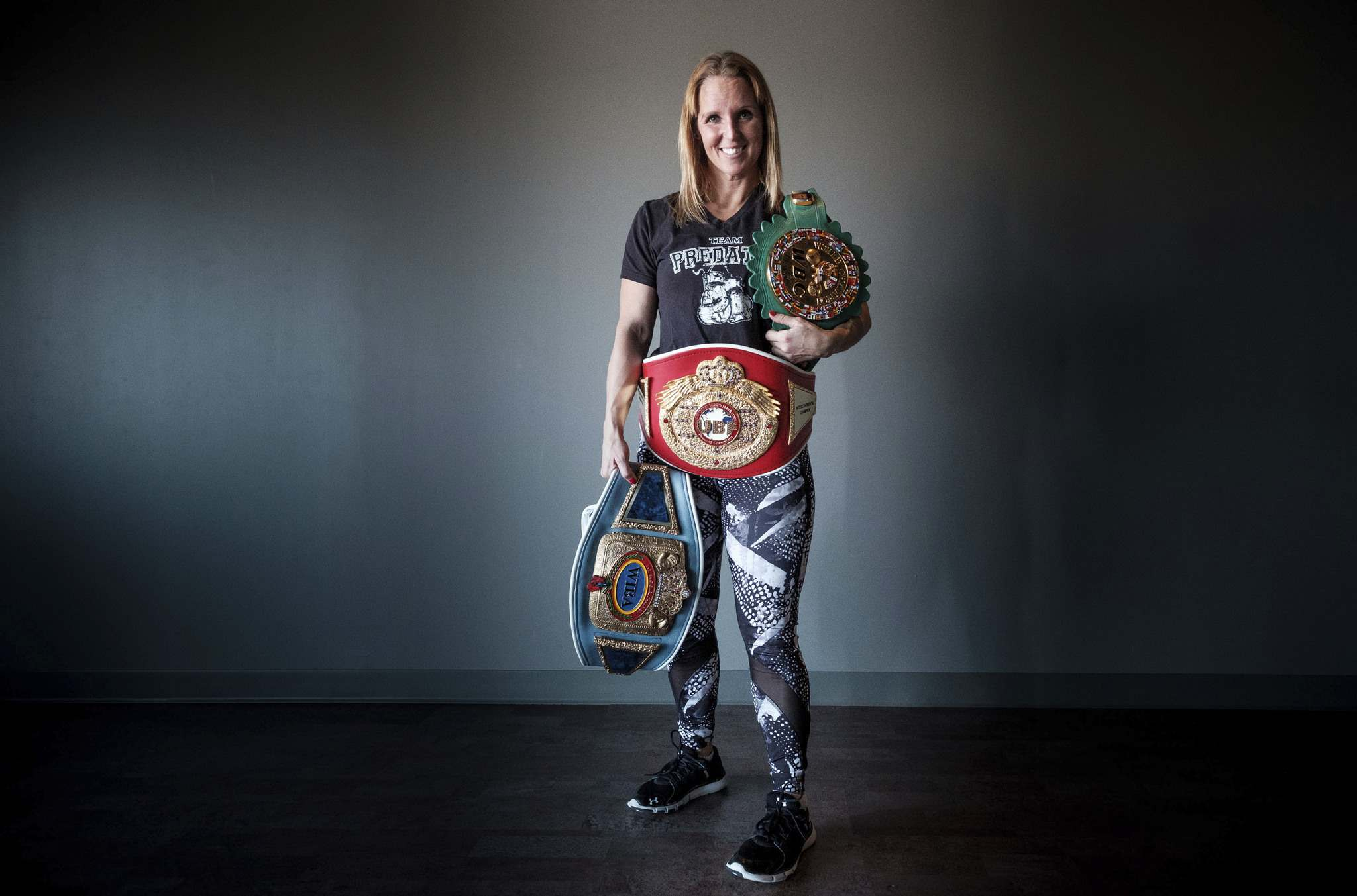 Gerula with her championship belts. (Daniel Crump / Winnipeg Free Press)</p>