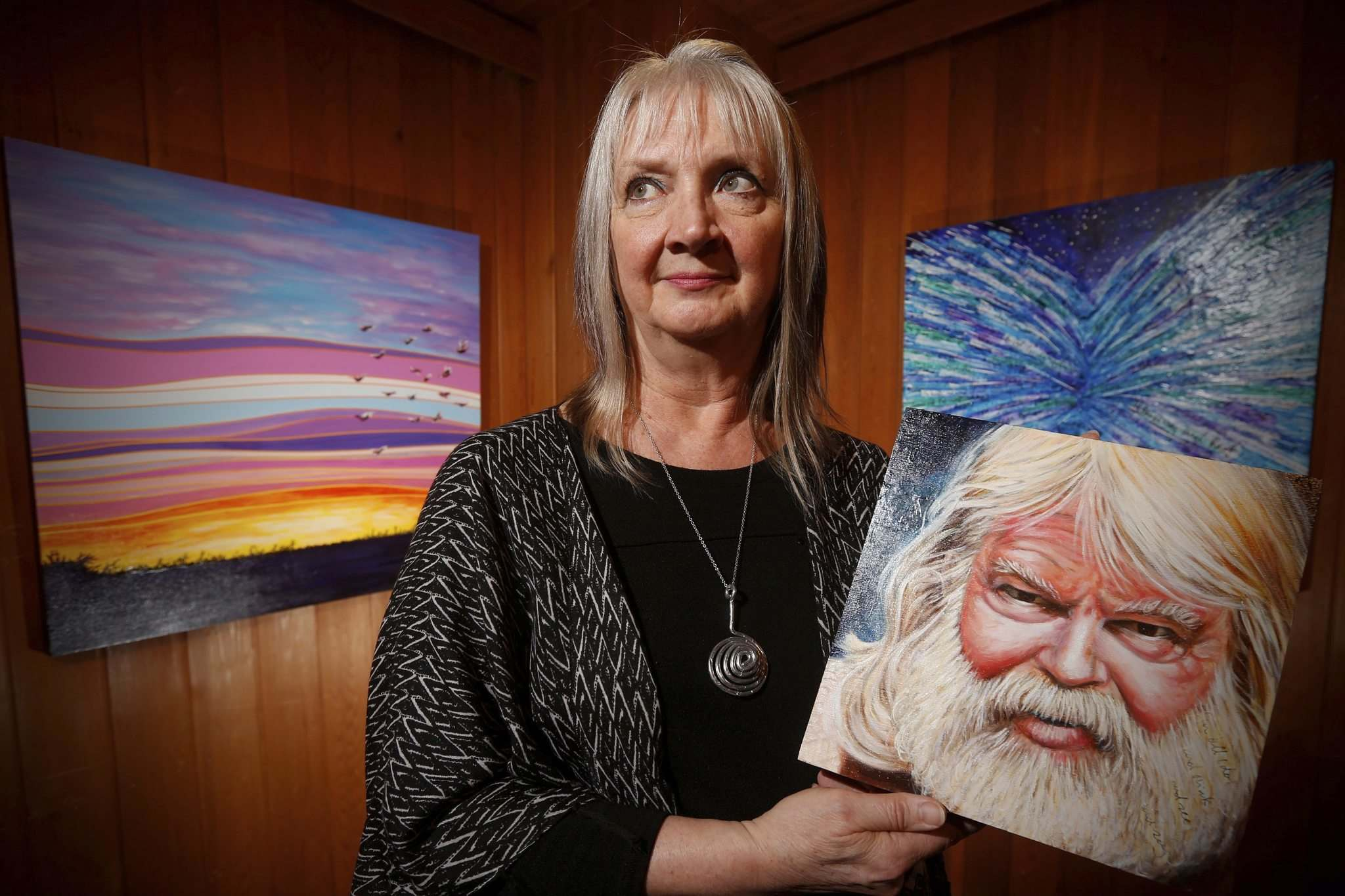Winnipeg artist Faye Hall holds a painting of English poet and Anglican chaplain Malcolm Guite at the Mennonite Heritage Centre Gallery. (John Woods / Winnipeg Free Press)</p></p>
