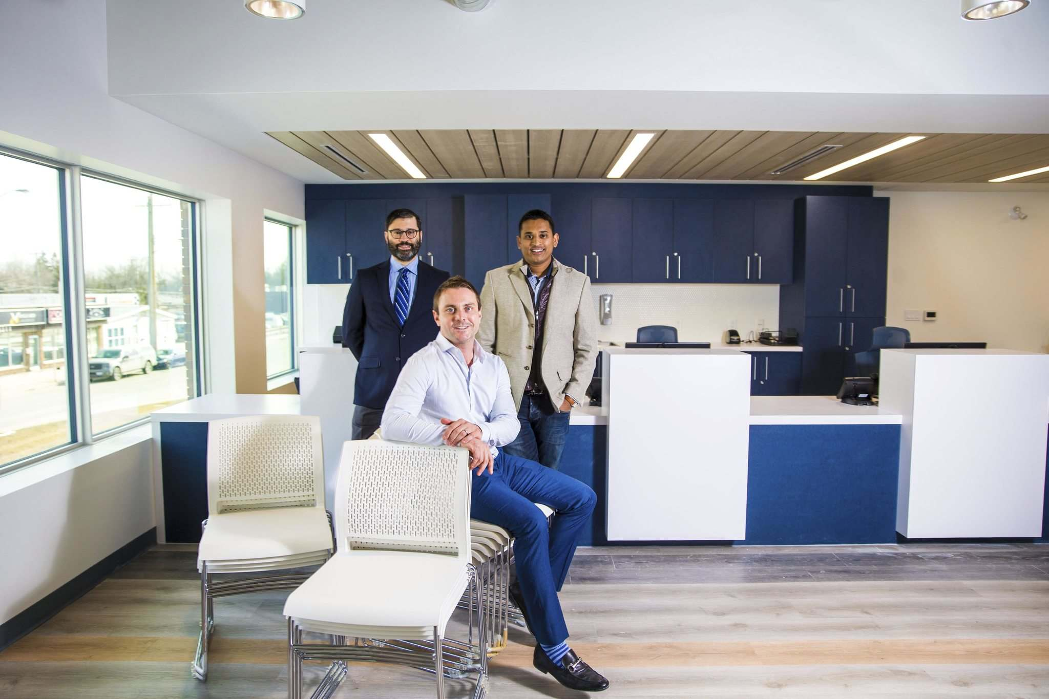 PHOTOS BY MIKAELA MACKENZIE / WINNIPEG FREE PRESS</p><p>Dr. Sacha Rehsia (from left), Darren Murphy of Northway Pharmacy and Dr. Andy Dandekar show off the renovated reception area at the Charleswood Medical Clinic. </p>