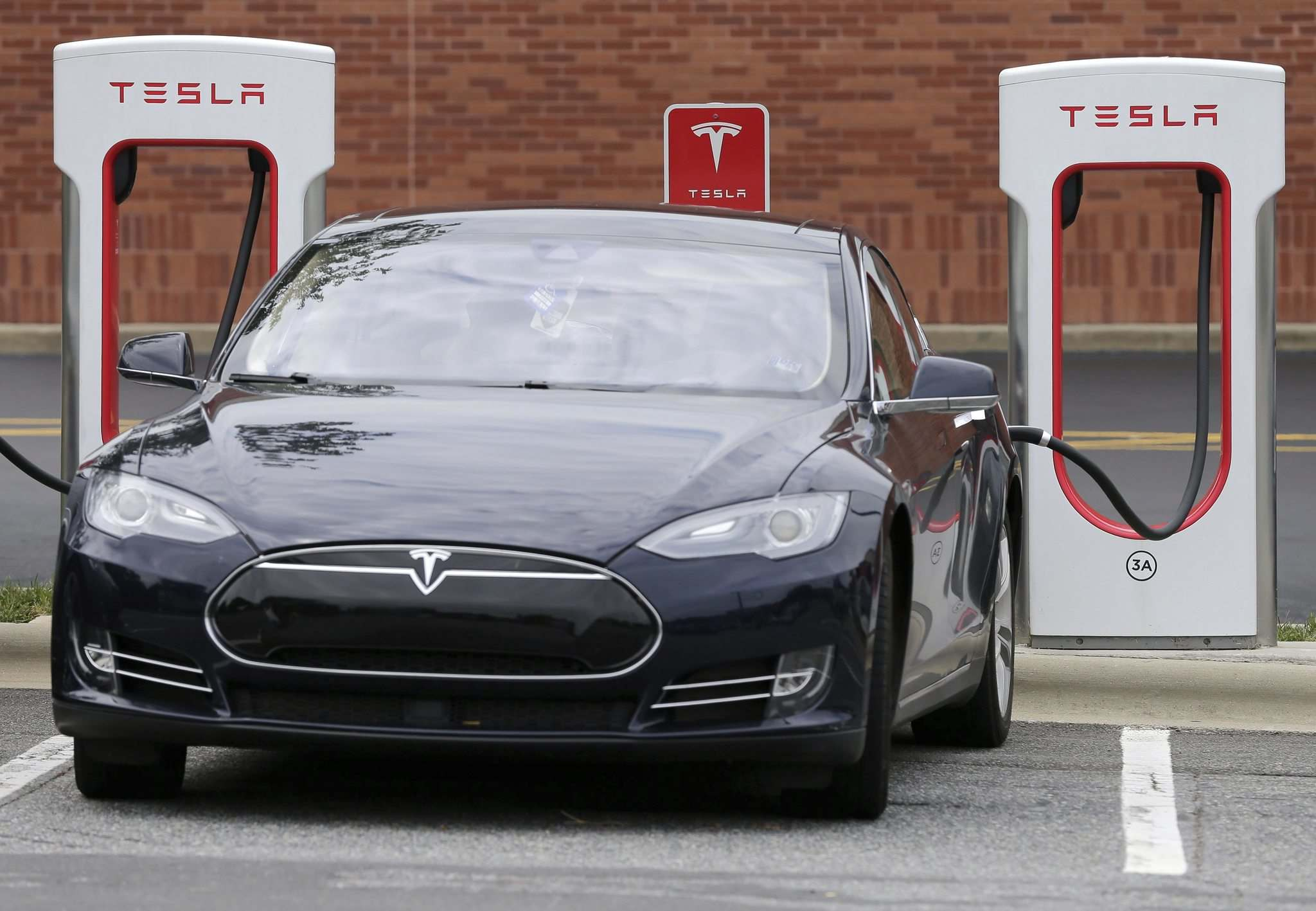 Chuck Burton / The Associated Press files</p><p>A Tesla Supercharger station is scheduled to open in Portage la Prairie this summer. Winnipeg and Brandon are also slated for stations.</p></p>