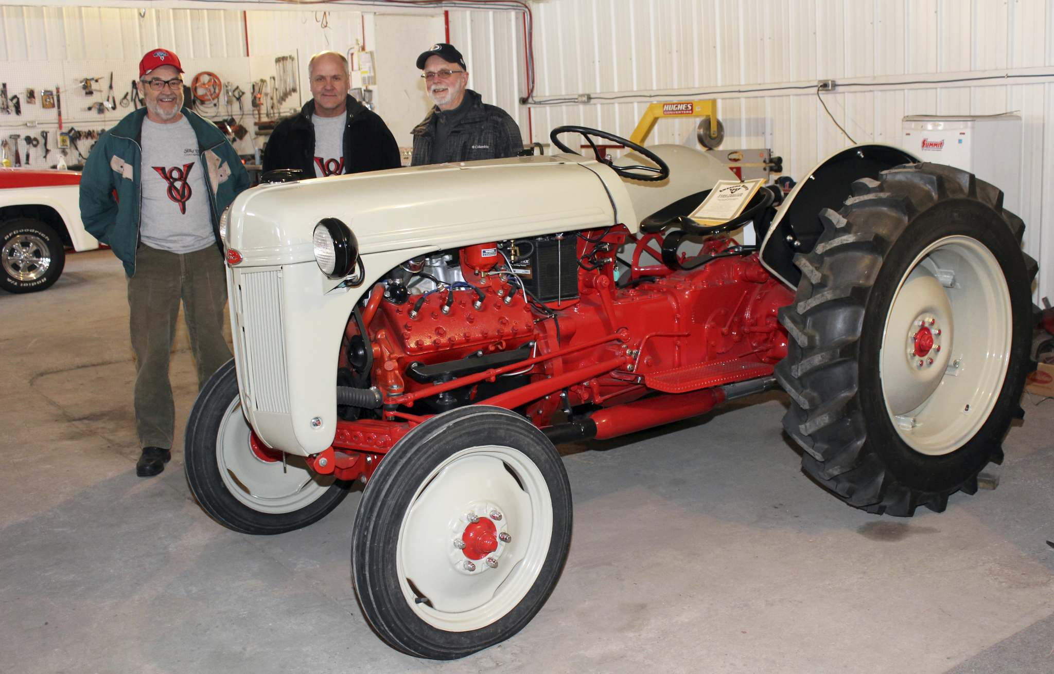 In 2012, Brian Burrows (left) bought this Ford 8N tractor that hadn't run in years. He enlisted the help of Rick Geisbrecht (centre) and Al Holmberg to find the parts and put in the elbow grease to get it working again. (Photos by Larry D'Argis / Winnipeg Free Press)