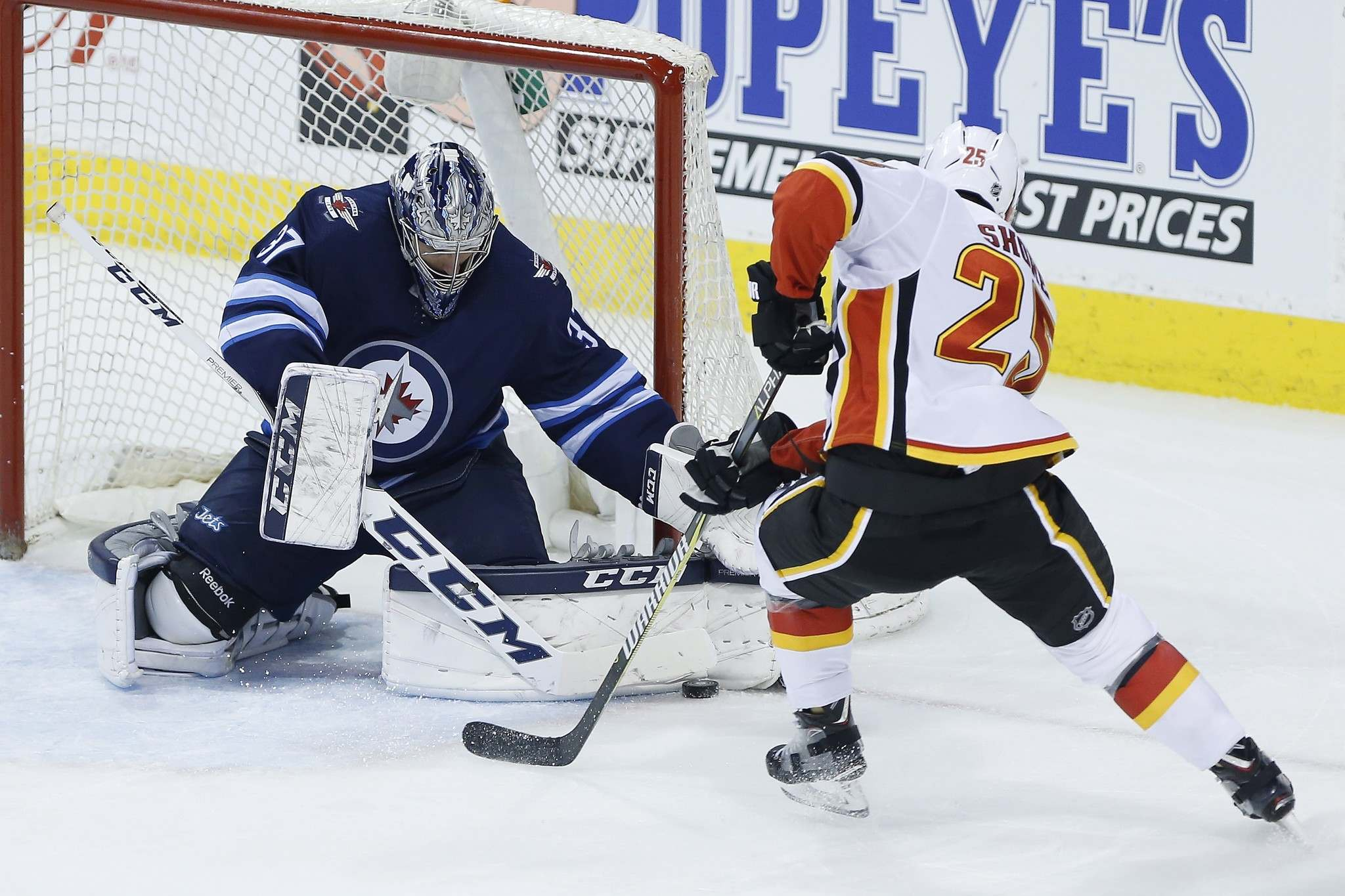 <p>Winnipeg Jets goaltender Connor Hellebuyck saves the breakaway attempt by Calgary Flames&#39; Nick Shore last Thursday. Hellebuyck is expecting the intensity to ramp up during the playoffs. &#34;I'm just going to try to stop every puck I possibly can.&#34;</p>