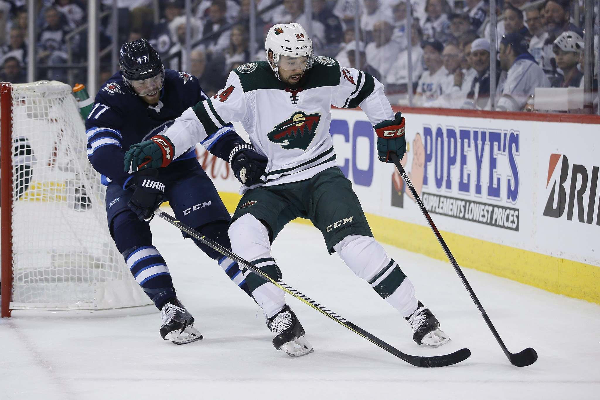 Lowry attempts to steal the puck from Minnesota Wild&#39;s Matt Dumba Friday night. (John Woods / The Canadian Press)</p>