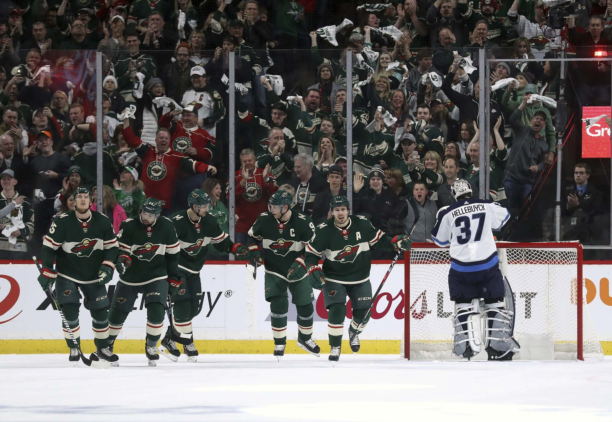 TREVOR HAGAN / WINNIPEG FREE PRESS</p><p>The Minnesota Wild celebrate after Zach Parise (11) scored on Winnipeg Jets&#39; goaltender Connor Hellebuyck (37) during first period NHL playoff hockey action at the Xcel Energy Center in St.Paul, Minnesota, Sunday, April 14, 2018.</p>