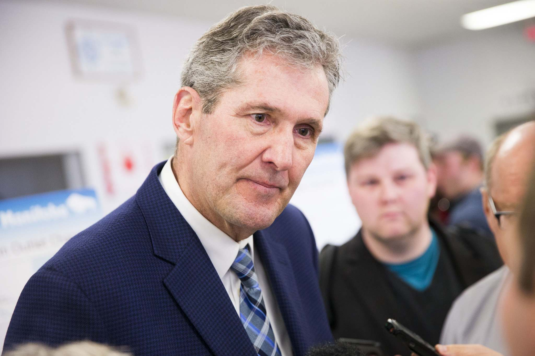 MIKAELA MACKENZIE / WINNIPEG FREE PRESS FILES</p><p>Premier Brian Pallister scrums with the media at a town hall on the proposed Lake Manitoba outlet in St. Laurent, Manitoba on Monday.</p>