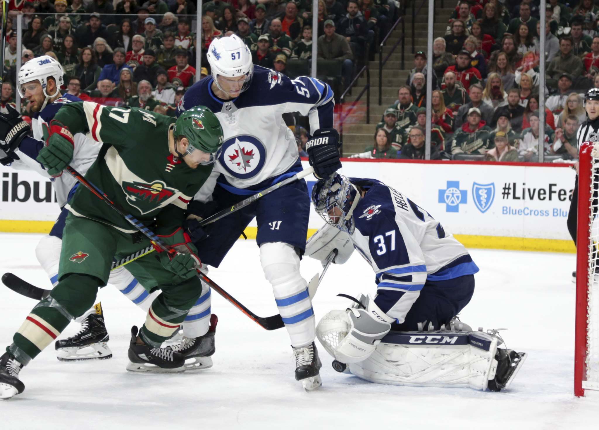 Wild left wing Marcus Foligno left tangles with Winnipeg Jets defenseman Tyler Myers in the first period of their game on Sunday. Myers would later leave the game after getting injured during a collision with Foligno