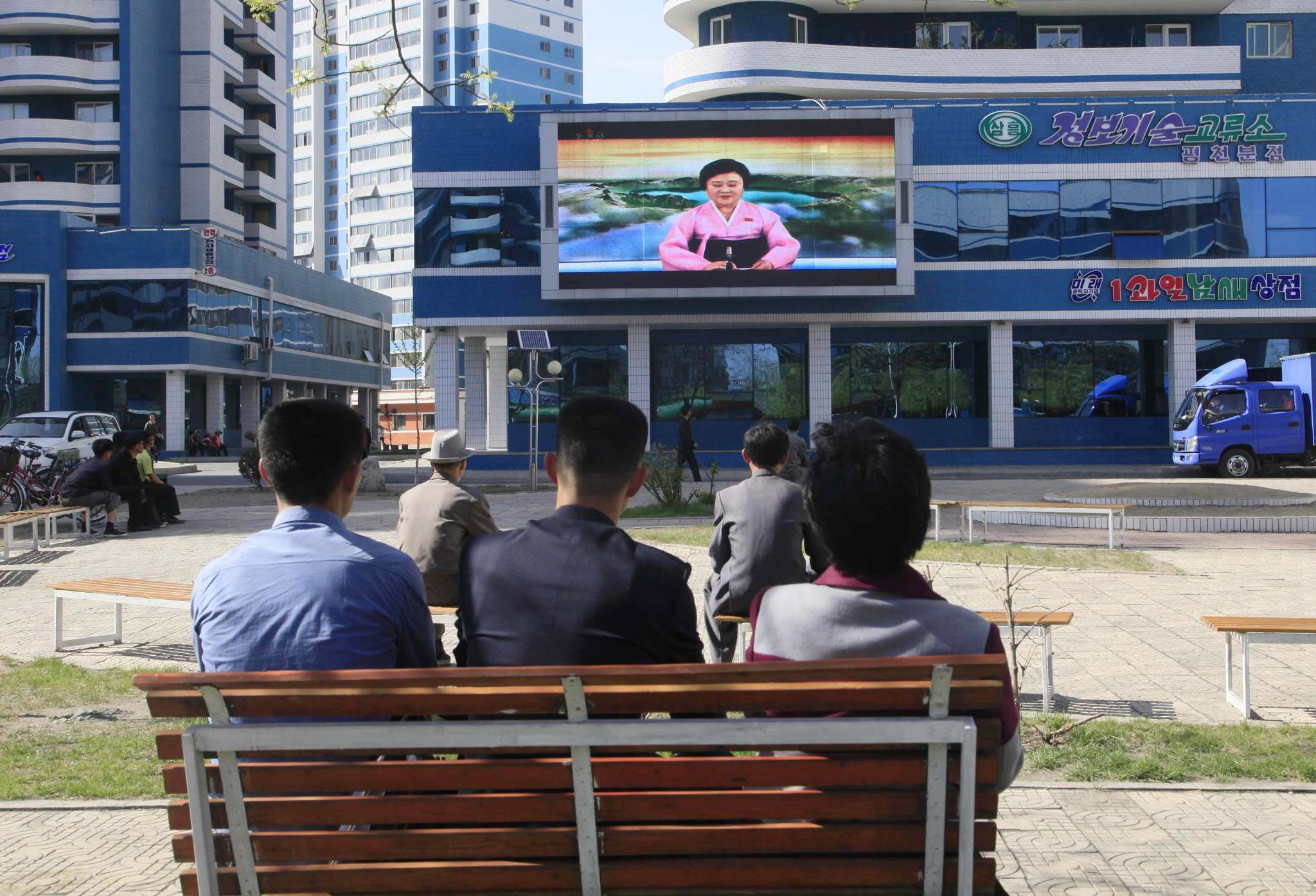 Jon Chol Jin / The Associated Press North Koreans watch as their country's most famous newscaster announces leader Kim Jong Un's proposal to suspend nuclear tests and long-range missile launches on a giant screen on Pyongyang's newly built Mirae Scientists' Street Saturday. U.S. President Donald Trump apparently took that to equate to denuclearization, but Kim called nuclear weapons the North's 'treasured sword.'</p>