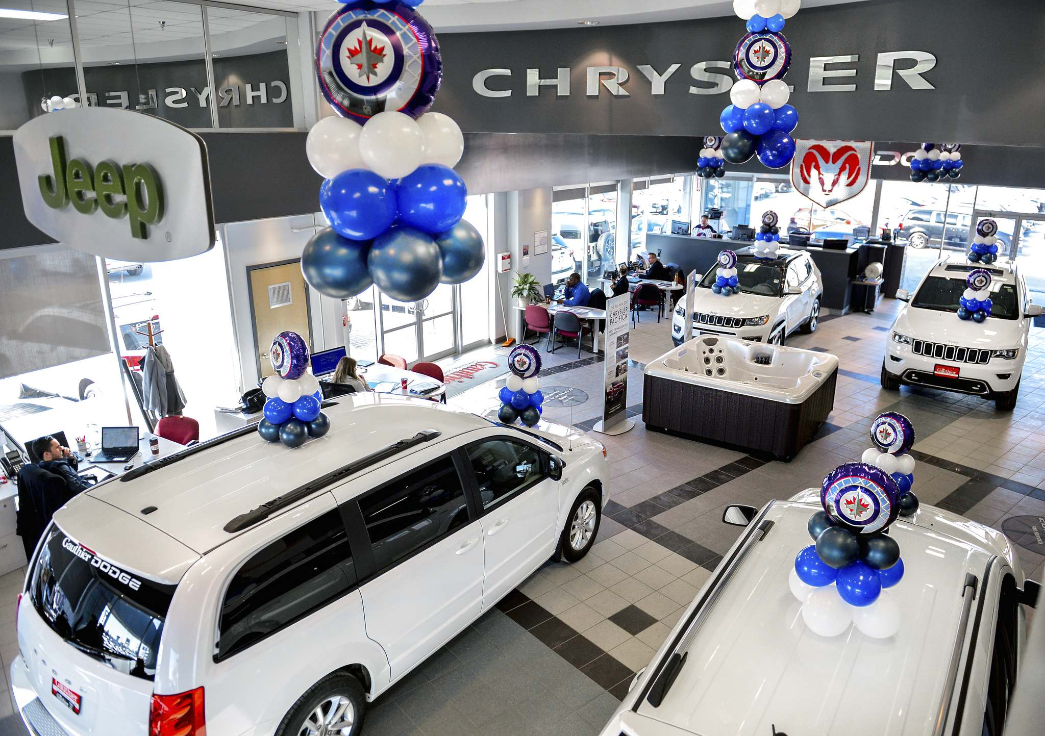 Supplied / Jeff Miller The showroom at Gauthier Chrysler is bedecked in white and filled with white vehicles to show pride for the Winnipeg Jets. It is one of several dealerships to do so.