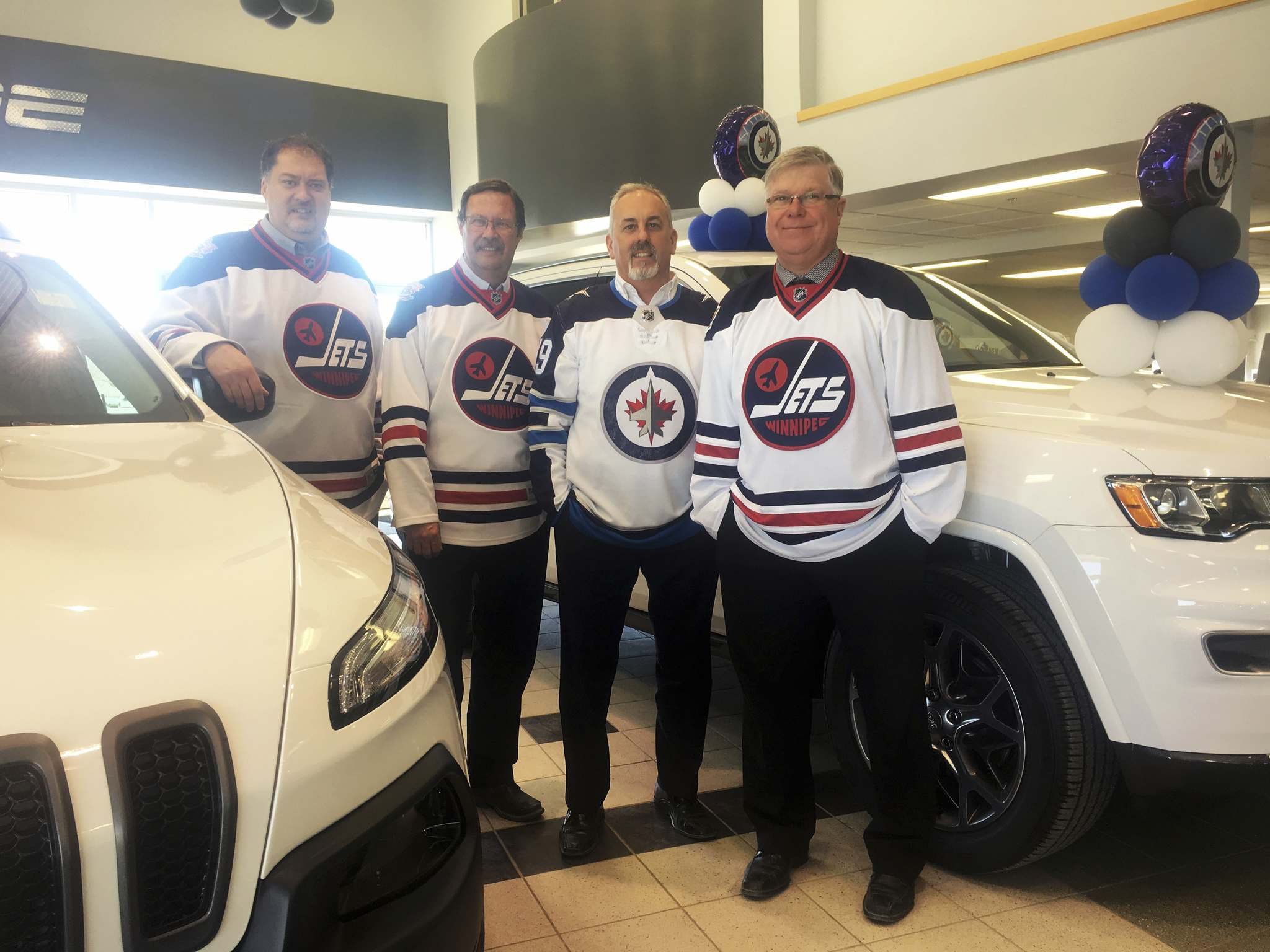 Willy Williamson / Winnipeg Free PressFrom left: Bryan Ambrozik, Marc Letourneau, Kevin Schumacher and Barry Olinkin from Gauthier Chrysler in their whiteout showroom.
