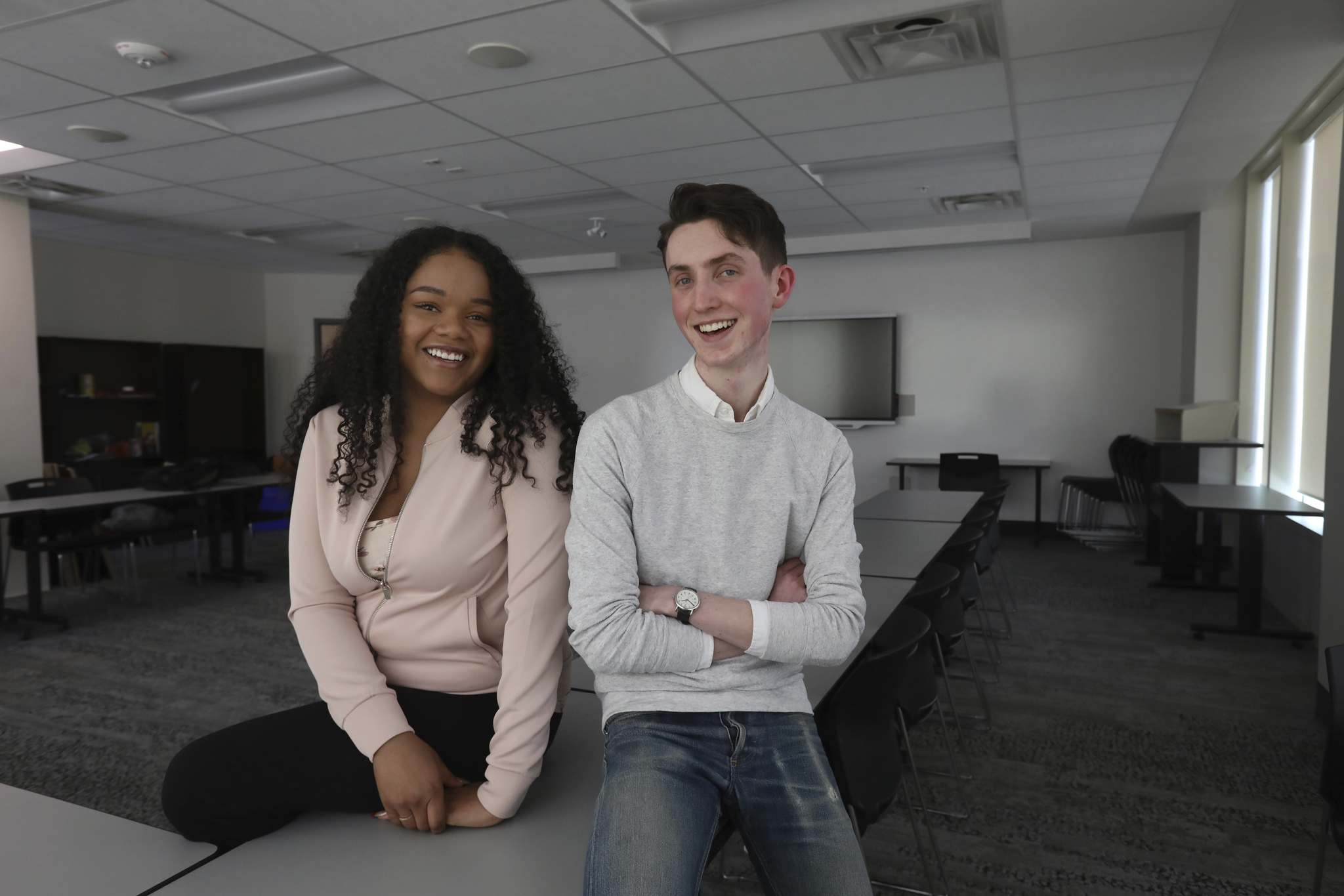 <p>Chelsea Bannatyne, left, and Riley Black are students in the Youth United@Winnipeg summer job program at University of Winnipeg Merchant&rsquo;s Corner campus.</p>