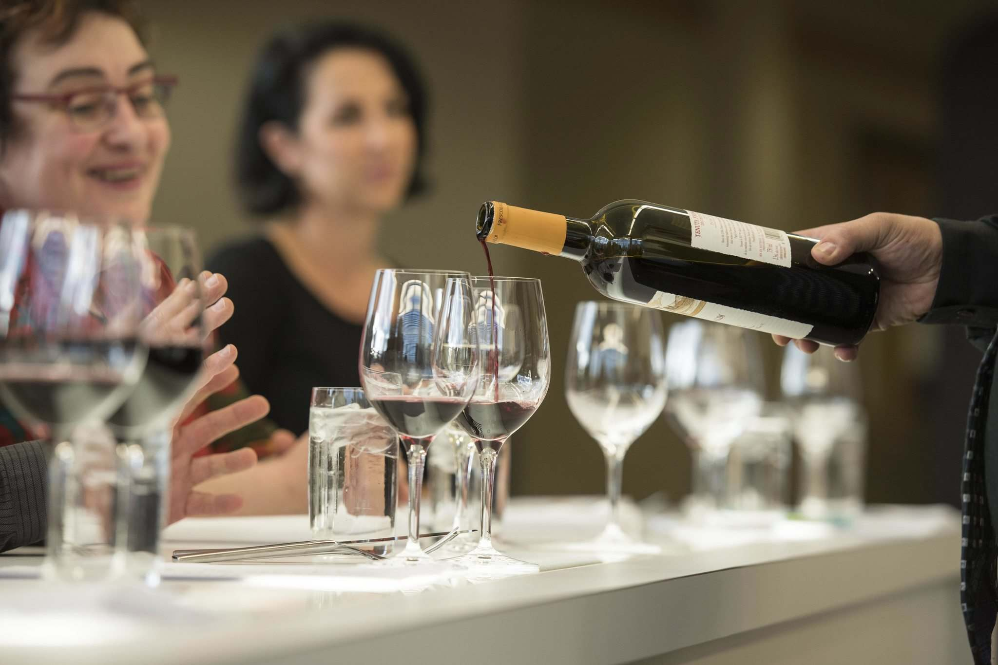 Wine pairings accompany a traditional Tuscan menu during the workshop.</p></p>