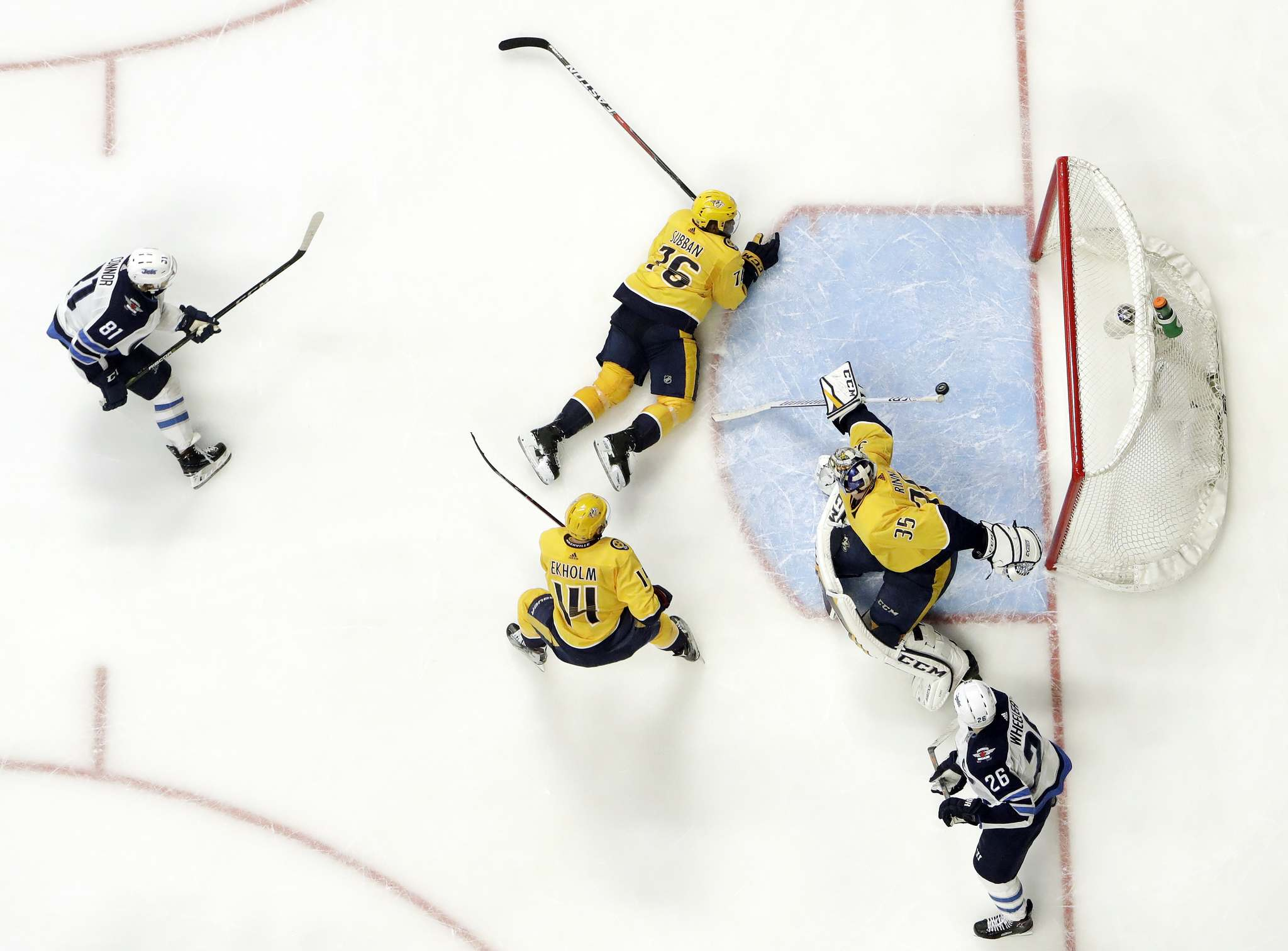 Winnipeg Jets left wing Kyle Connor (81) scores a goal against Nashville Predators goalie Pekka Rinne (35), of Finland, during the second period in Game 5 of an NHL hockey second-round playoff series Saturday, May 5, 2018, in Nashville, Tenn. Also defending for the Predators are Mattias Ekholm (14), of Sweden, and P.K. Subban (76). (AP Photo/Mark Humphrey)</p>
