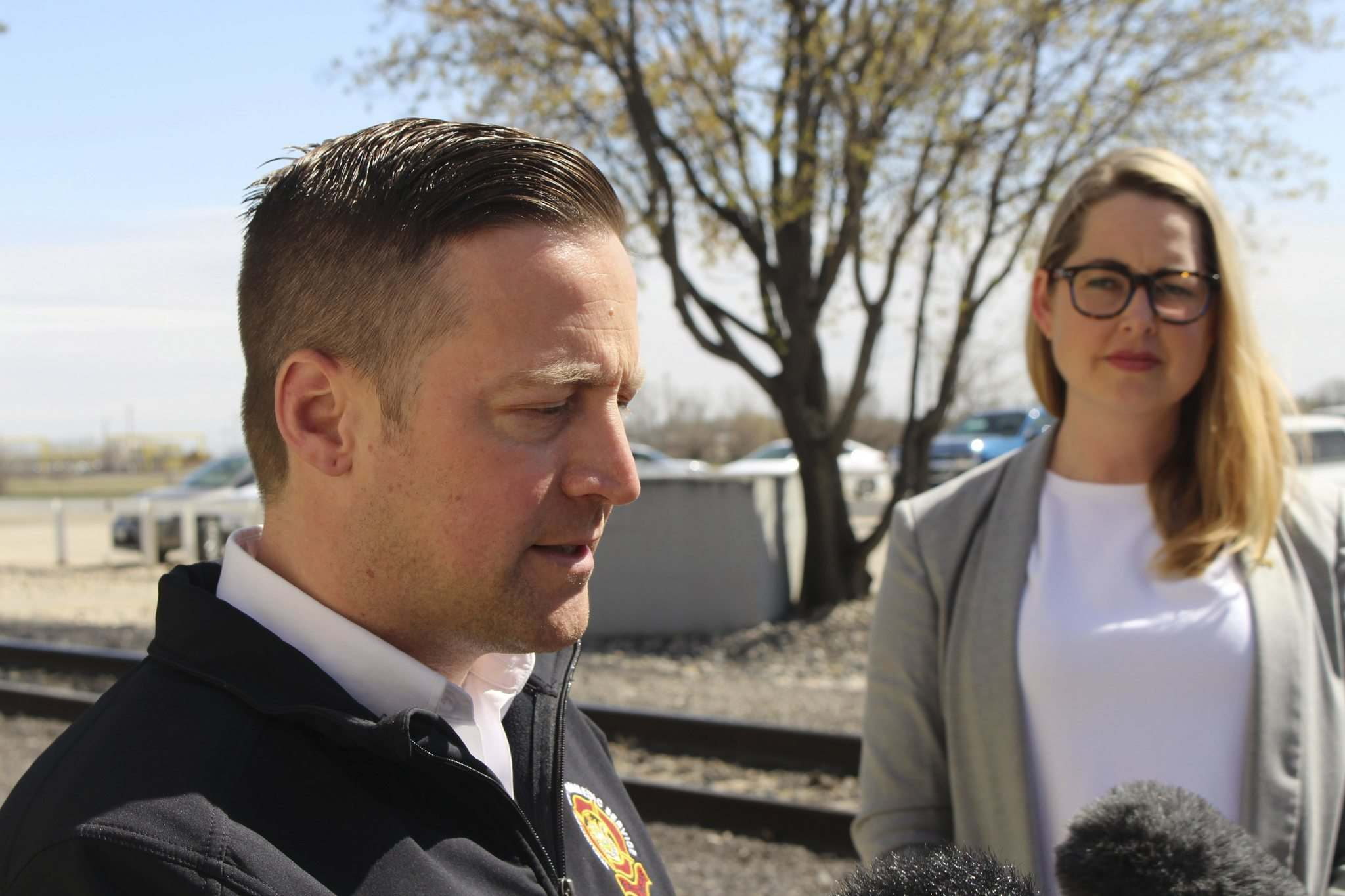 RYAN THORPE / WINNIPEG FREE PRESS</p><p>Tom Wallace, WFPS deputy chief, speaks to reporters Wednesday, following a meeting with the Canadian National Railway about a recent spate of brush fires in Winnipeg - some of which were sparked near train tracks. In background: Kate Fenske, spokeswoman for CNR.</p>