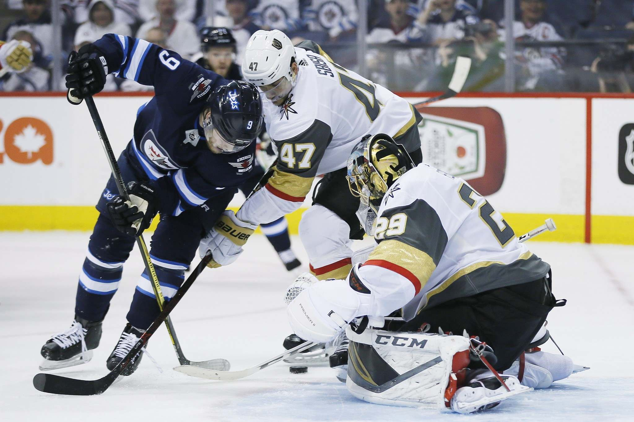 Vegas Golden Knights' goaltender Marc-Andre Fleury (29) knocks the puck away from Winnipeg Jets' Andrew Copp (9) as Knights' Luca Sbisa (47) defends during second period of game one action in the NHL Western Conference Final in Winnipeg on Saturday, May 12, 2018. THE CANADIAN PRESS/John Woods</p>