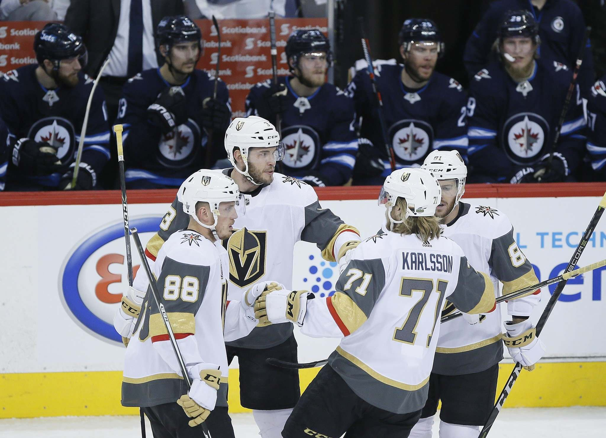 Vegas Golden Knights&#39; Nate Schmidt (88), Brayden McNabb (3), William Karlsson (71) and Jonathan Marchessault (81) celebrate McNabb&#39;s goal against the Winnipeg Jets during first period of game one action in the NHL Western Conference Final in Winnipeg on Saturday, May 12, 2018. THE CANADIAN PRESS/John Woods</p>