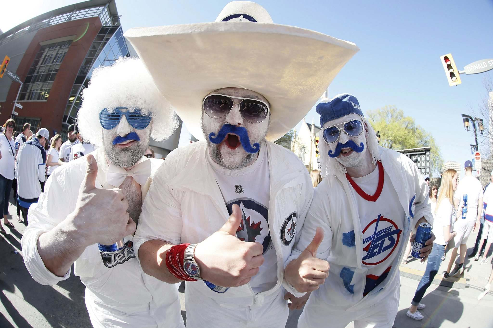 John Woods / The Canadian Press Files</p><p>Fans Aaron Wold (from left), Shawn Machado and Jason Krucish show their Jets pride prior to the first game of the Western final against the Vegas Golden Knights.</p></p>