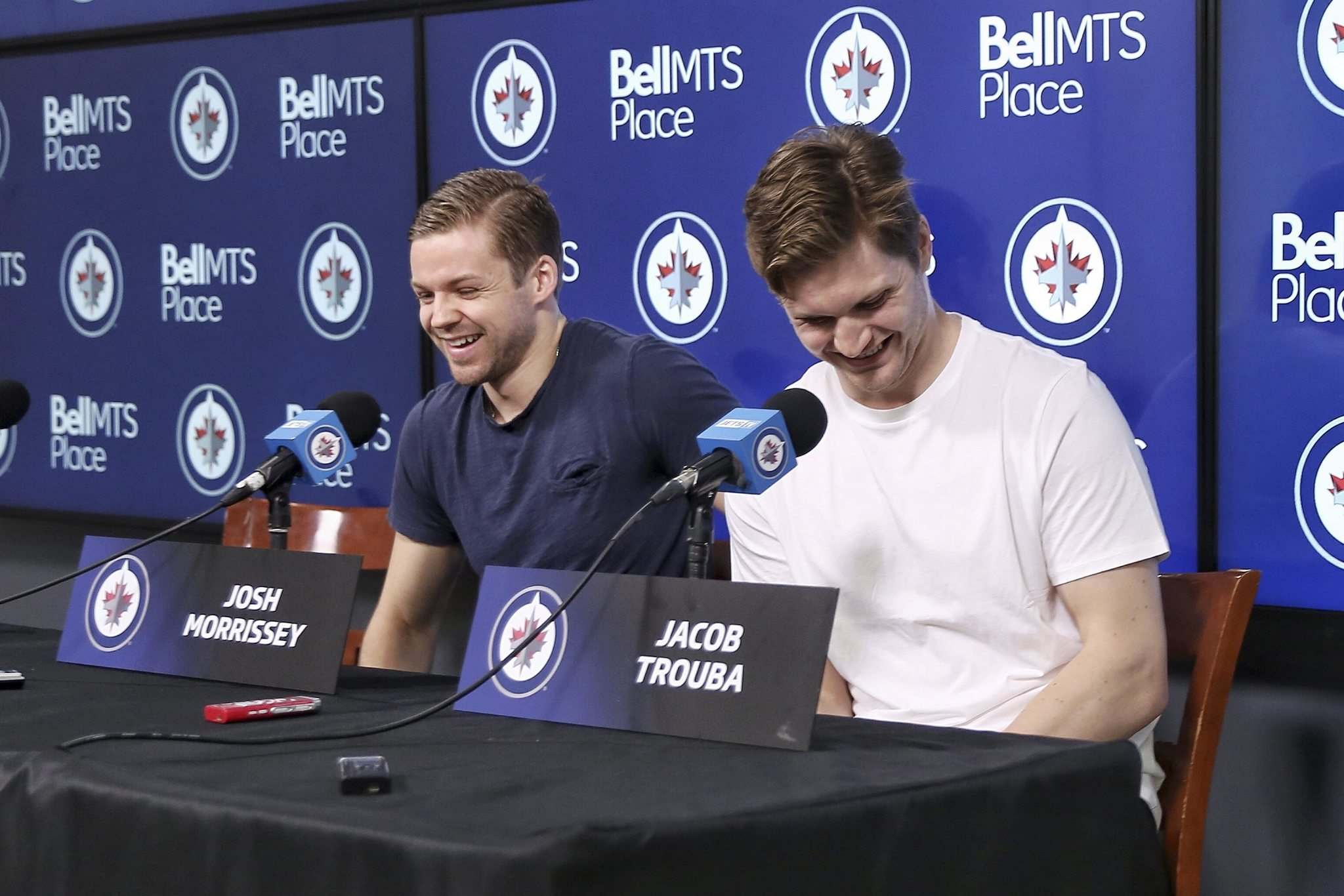 Jacob Trouba (right) and Josh Morrissey at their final press conference of the season at Bell MTS Place on Tuesday. (Mike Deal / Winnipeg Free Press) </p>