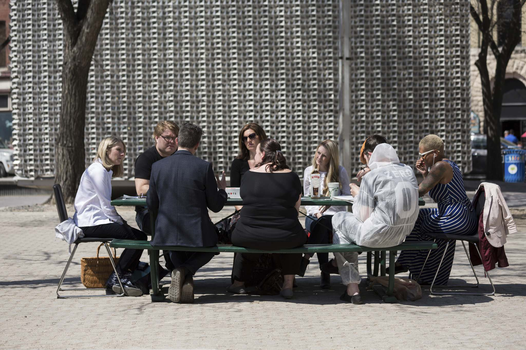 Lindsay Reid photo</p><p>Panel members discuss urban and rural public stages and performance spaces at a picnic table in front of the Cube in Old Market Square.</p>